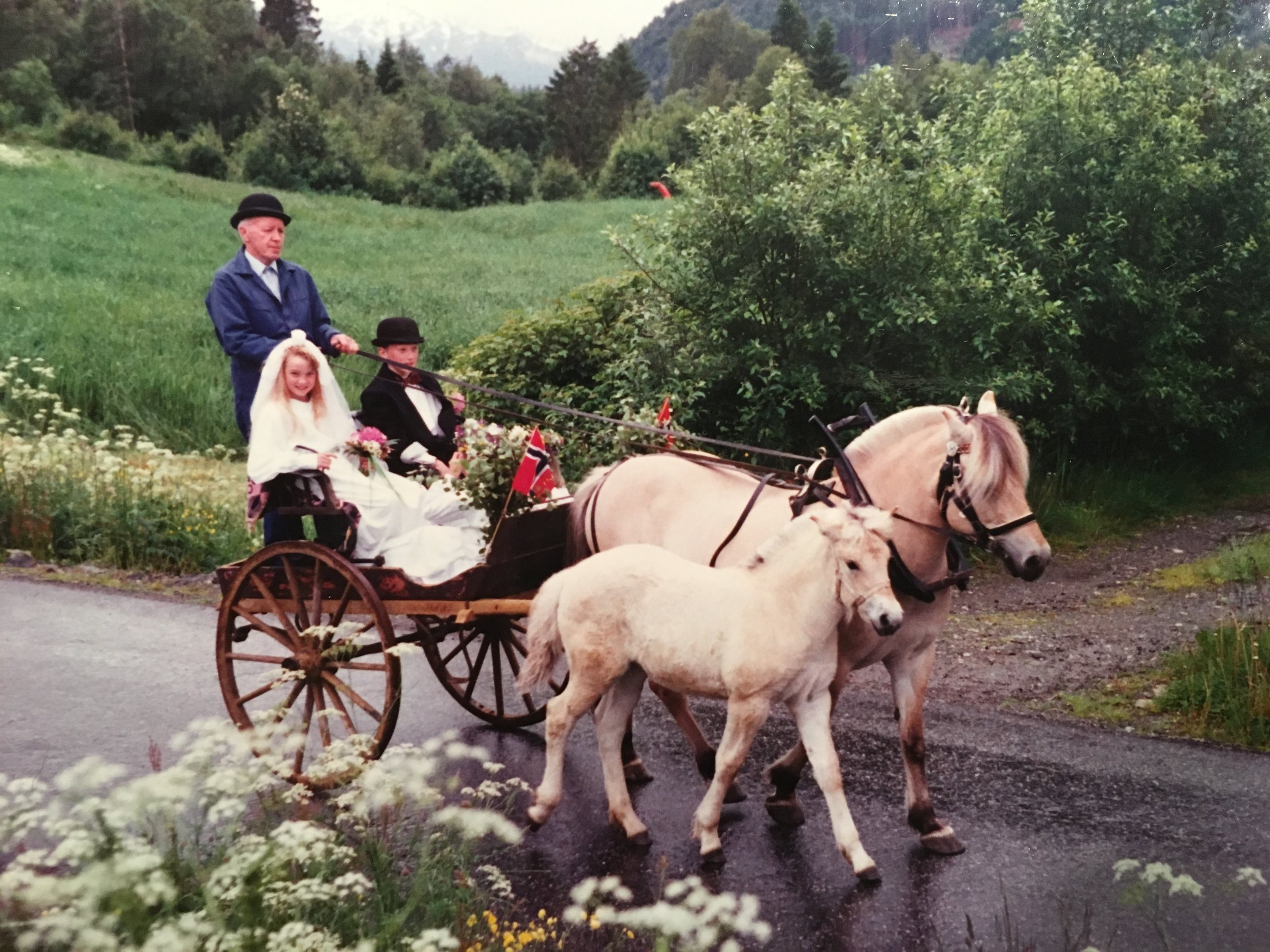 Me and next door neighbor Jenny as mid summer-newlyweds. Grandpa and his horses carrying us around.