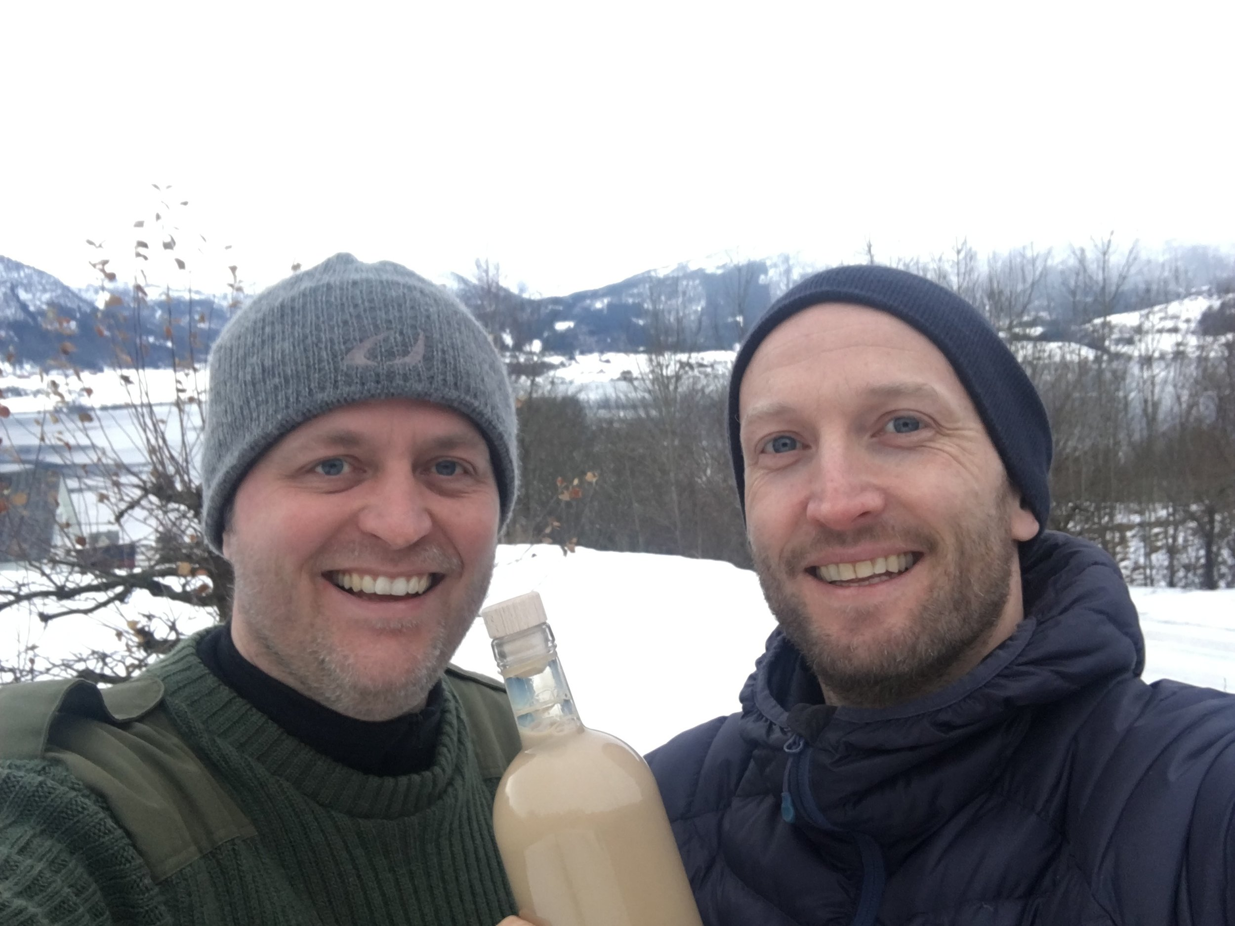 Jann Vestby and Øyvind Løkling with the first Fjording bottle. Gloppefjorden, a part of Nordfjorden, in the background.