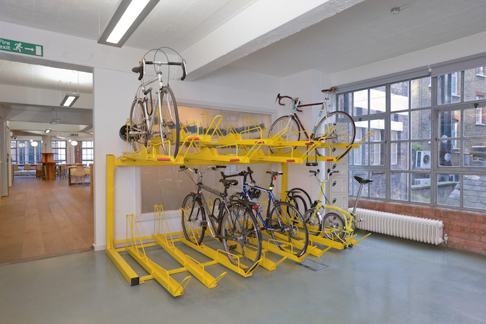 OUR TAKE: IDEO knew many of their employees cycled to work, but their previous bike storage was messy and insufficient. We incorporated a two-tiered solution that not only became an interesting and useful feature, it encouraged more employees to take up cycling to the office.