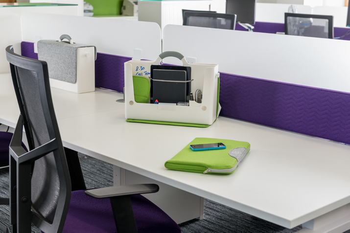 The hotbox hb-two portable office storage sits on an office desk opened, revealing its storage compartments.