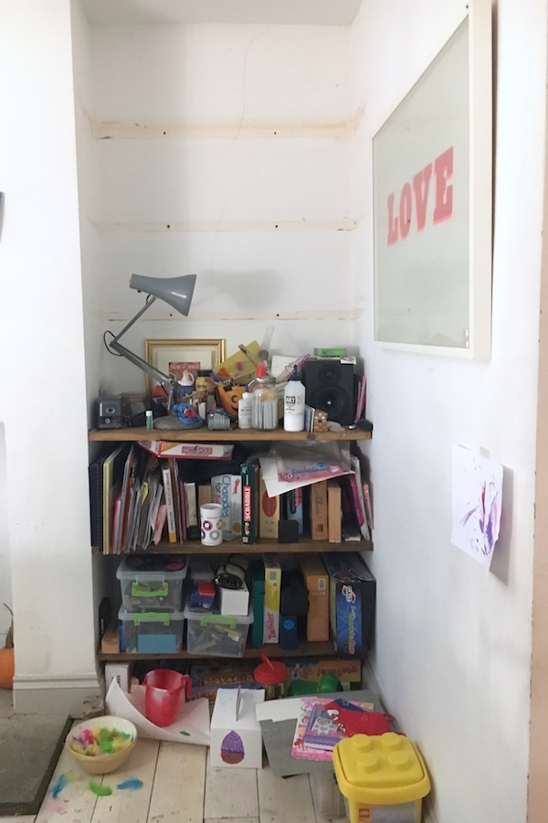 A 'before' photo of a disorganised, messy bookcase is filled with books, toys, papers and bottles.