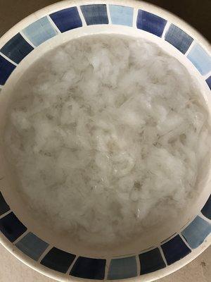 Soak in warm water to loosen