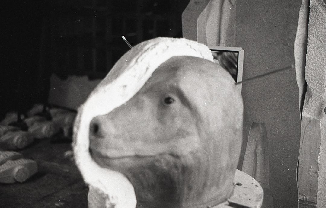 - A plaster cast is taken from the clay head with a split line down the middle.