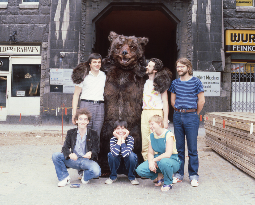 - The crew in the bear`s den.Andrew (yellow strides) and Bernadette ( green boiler suit ) were soon to make their GmbH company in Berlin.