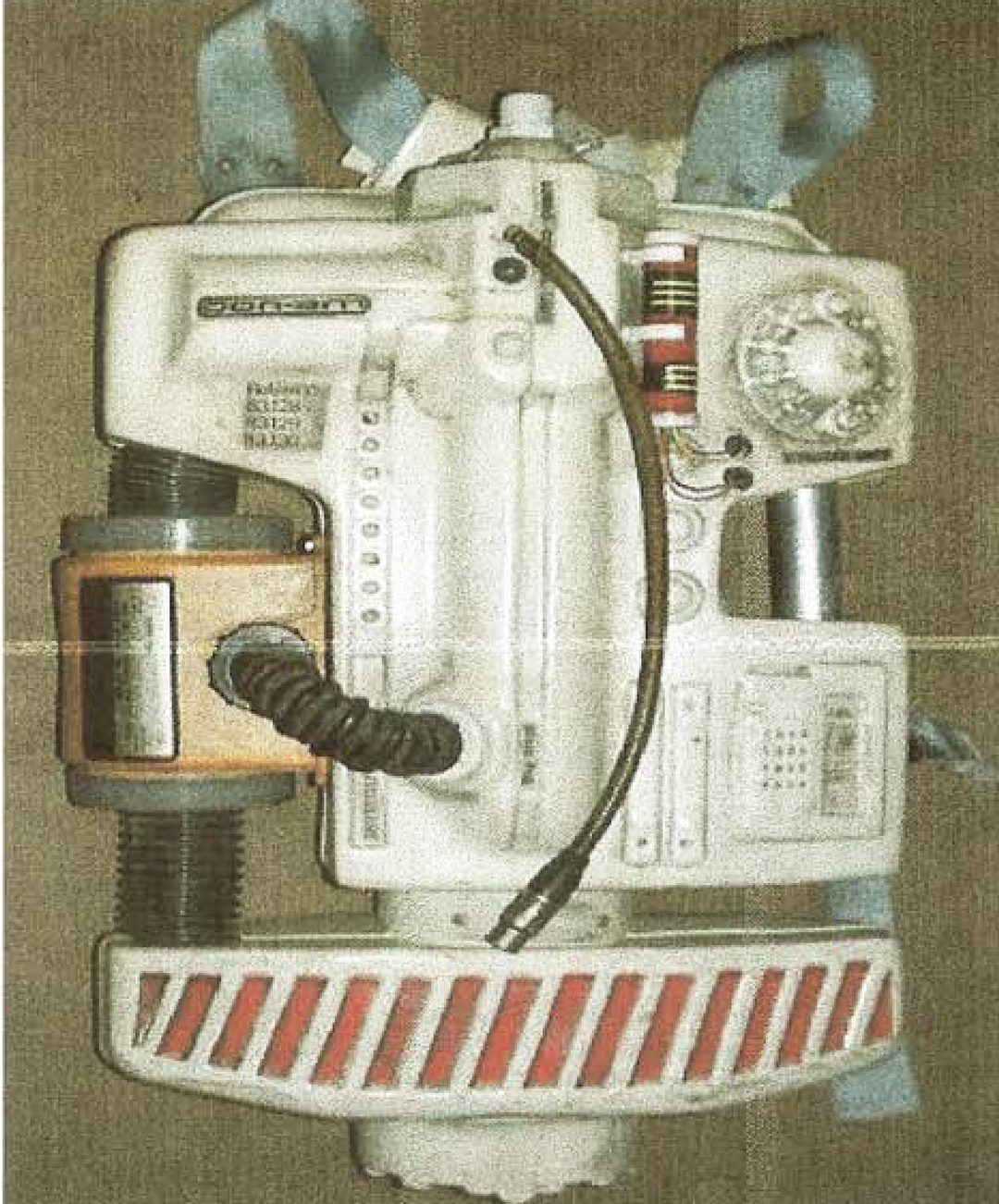 Design of the Back Pack - The functionality of the air circulating system more or less determined the overall shape of the Back Pack. It had to house the Martindale filter and incorporate a feed from the back of the helmet.The rest of the design of the Back Pack was covered in `Greeblies`.. Odds and ends of embellishments to satisfy the imagination of what the item would possibly look like.This always was a fun part of creating film props, especially as it often relied on whatever was lying around on the shop floor.