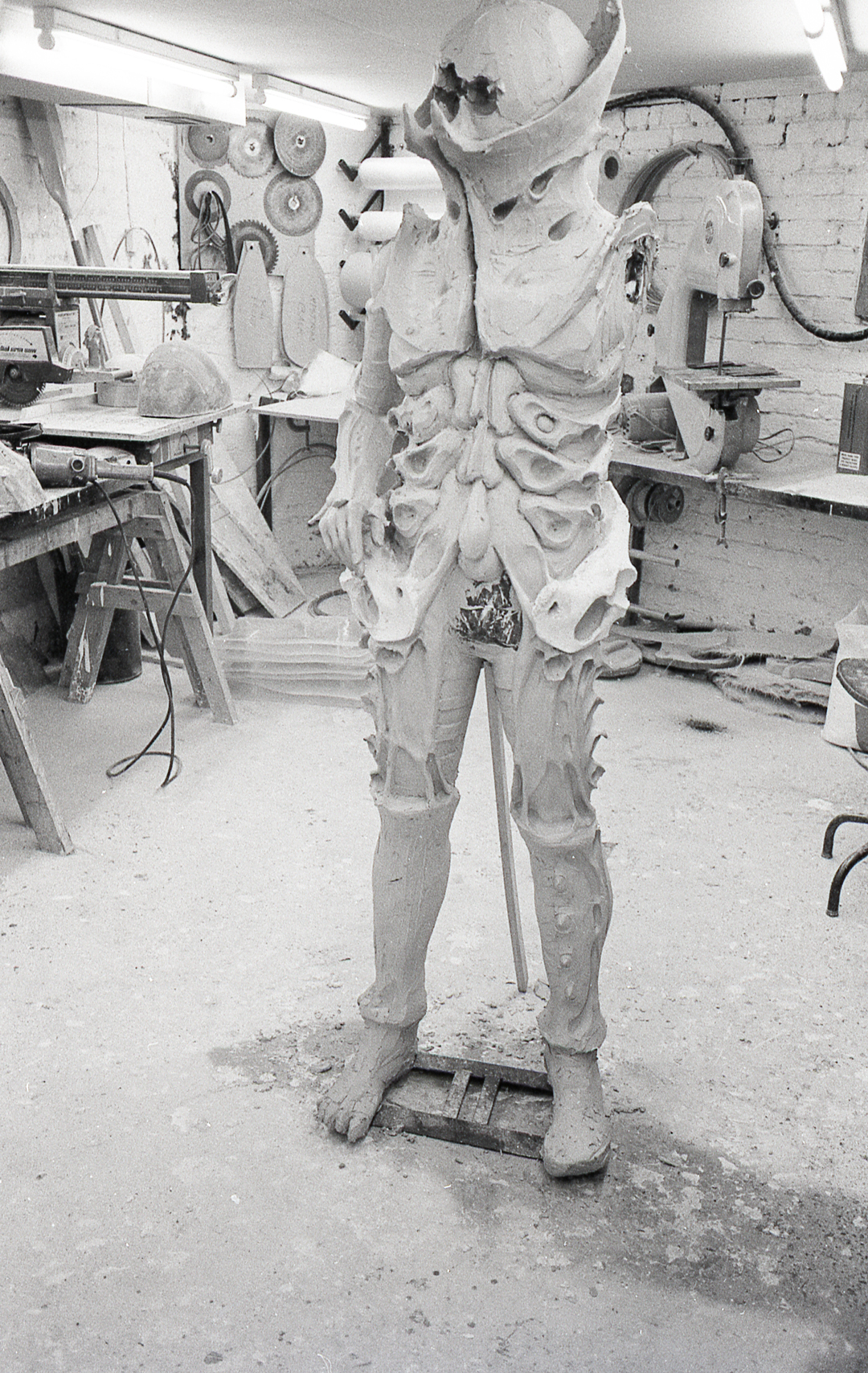 Creating a `Beast` - Andrew sculpted the character in clay over a regular mannequin. The body was then section up to cast plaster moulds to reproduce the surface texture. These were set in a framework with an internal mould face, thus creating a cavity.The framework had clamping devices that allowed Polyurethane cushion foam to be injected into the cavity. The plaster faces of the mould were washed with latex rubber, which coagulated on the surface forming a flexible skin.The result was a body piece that had a durable rubber surface, backed up by a flexible cushion foam.When all joined together, the finished warriors costume not only was durable enough for fighting, but it offered a significant amount of protection for the actors.