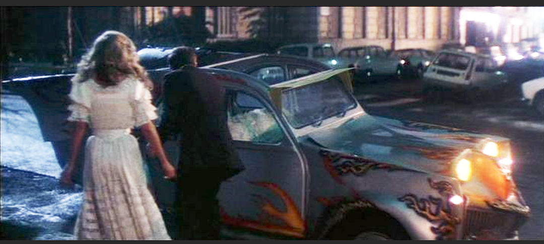 `Step into my Limousine` - This scene shows inspector Clueso offering a ride in the Silver Hornet to his lady love.Obviously he is proud of his wonderful automobile.