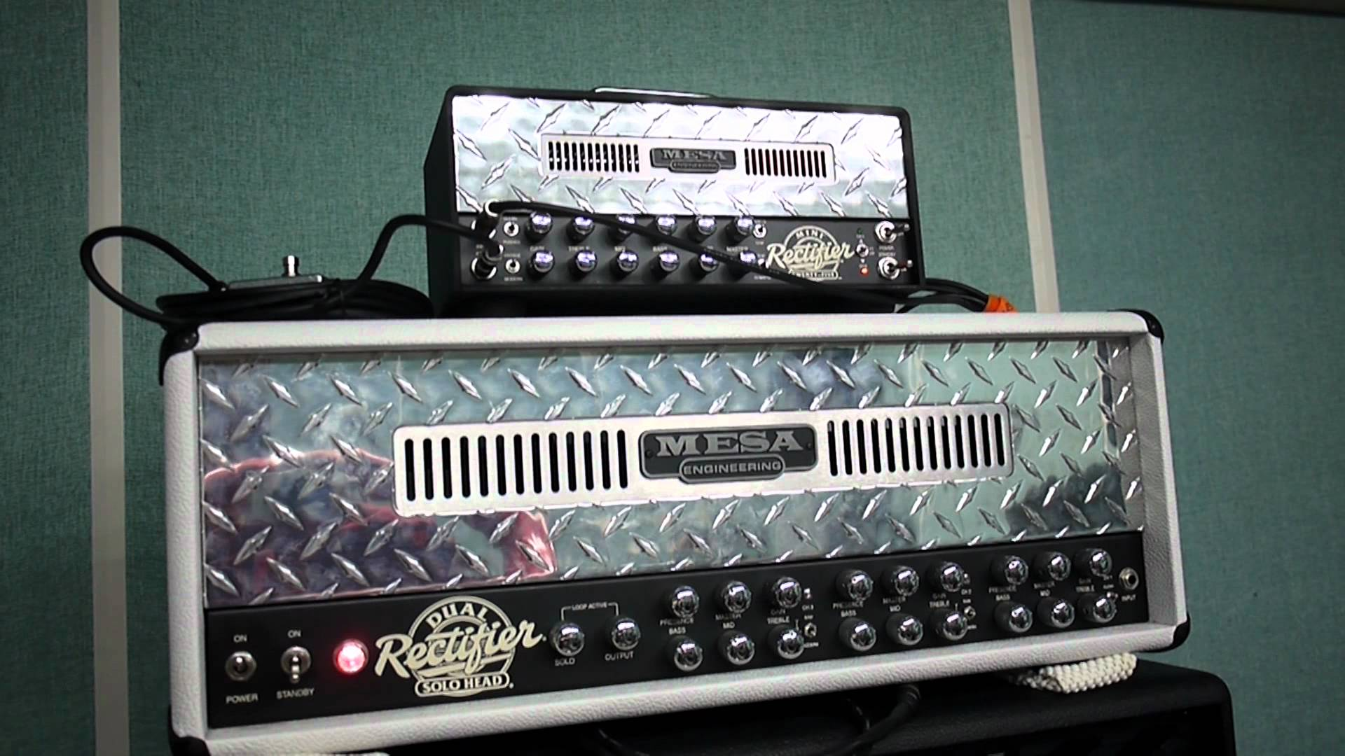 On top, the Mini Rectifier lunchbox amp from Mesa Boogie, sitting on top of it's big brother, the 100W Dual Rectifier.