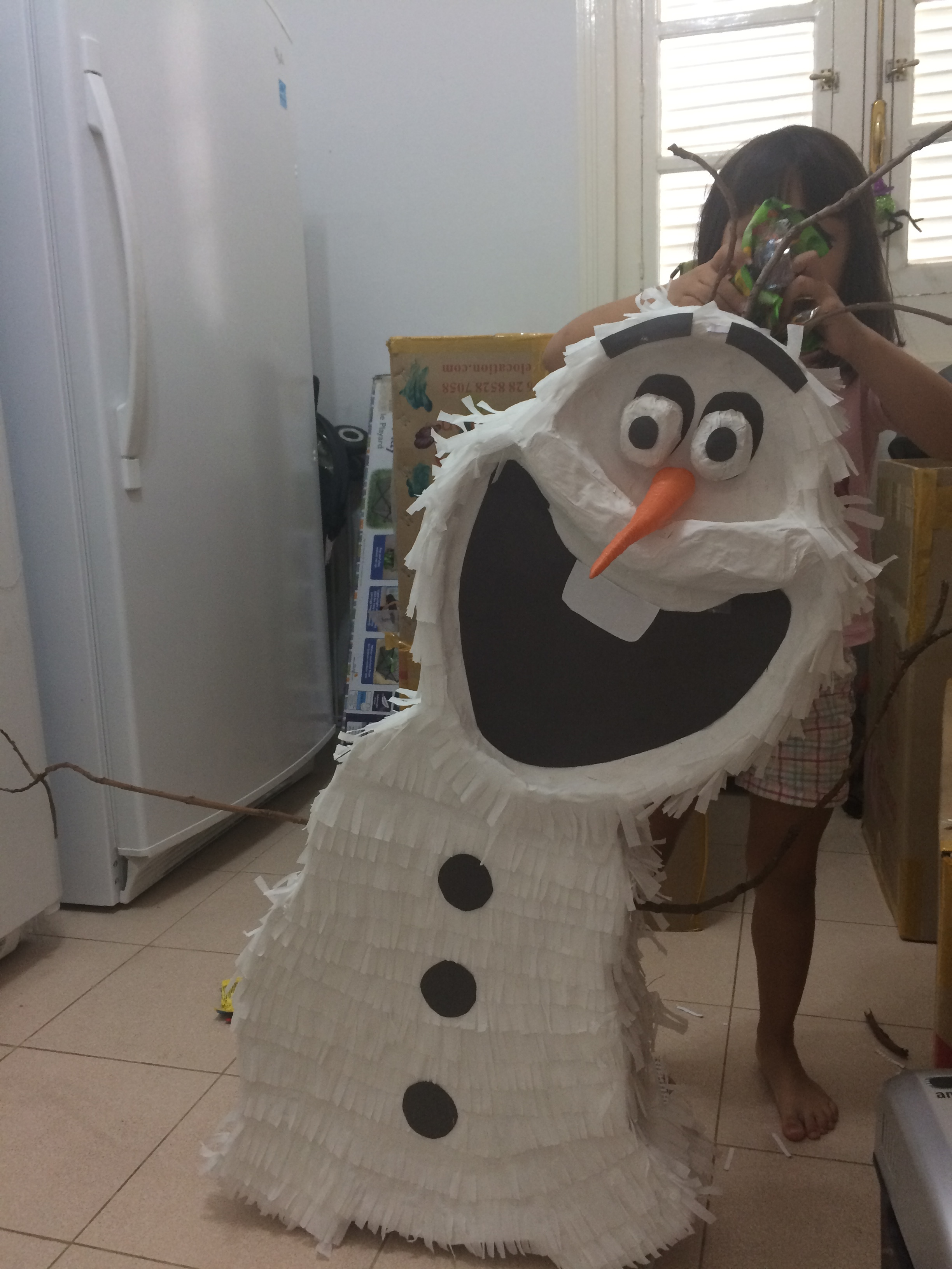 """Stuffing our Olaf piñata with candy brought over to Cuba by """"mules."""""""