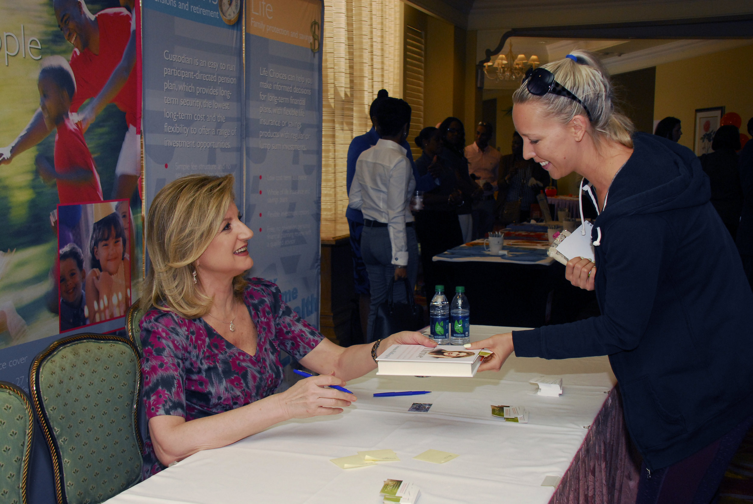 Ms. Huffington signed books for attendees after Saturday's public talk.