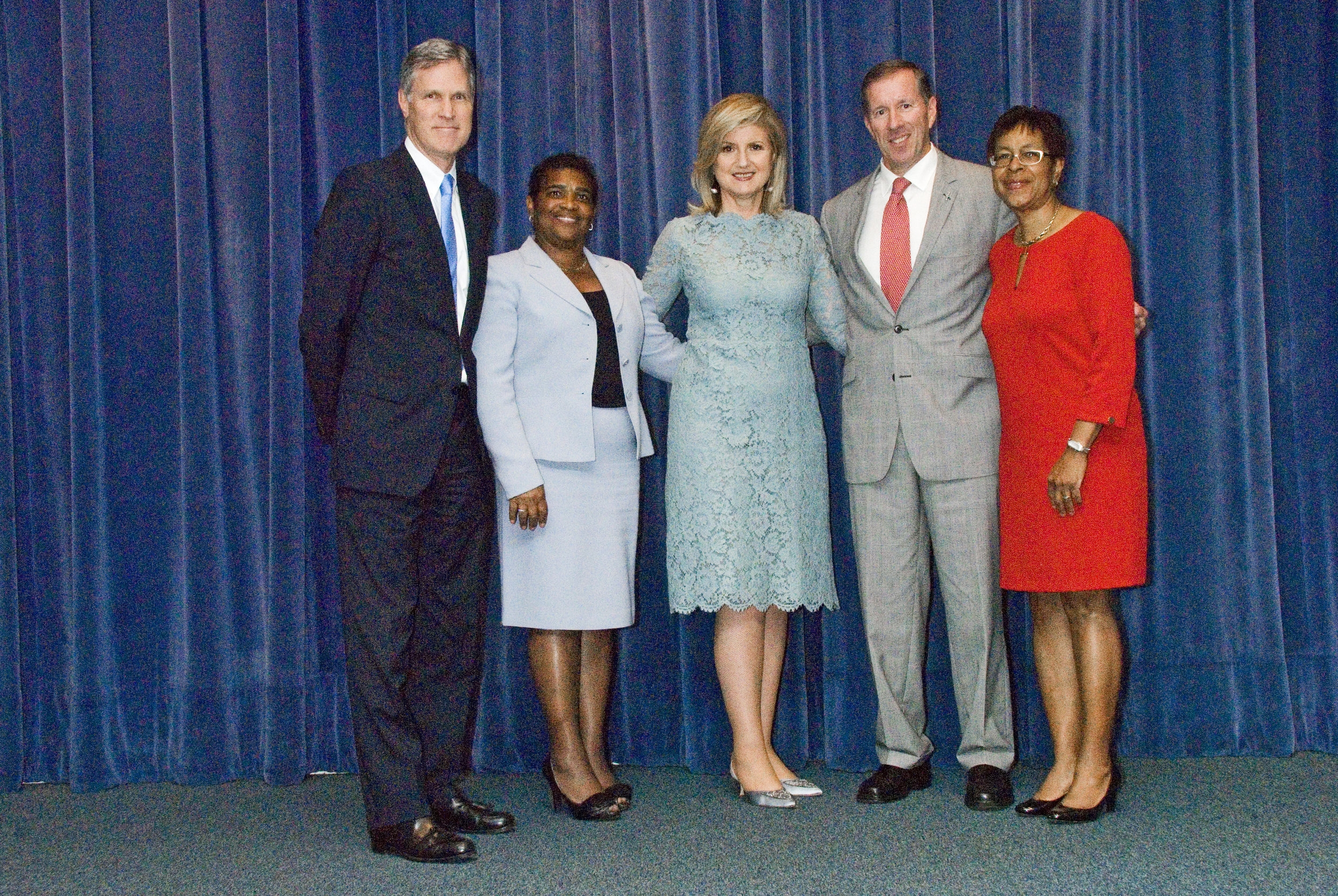 Ms. Huffington (center) with (left to right) Dr. Grant Gibbons, Minister Pamela Gordon-Pamplin, Premier Michael Dunkley and Minister Jeanne Atherden.