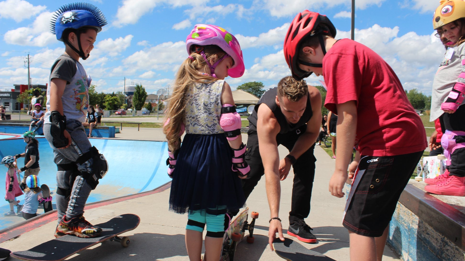 Pictured: Nathan teaching his skateboarding students new skills that can apply to skateboarding but also to life.