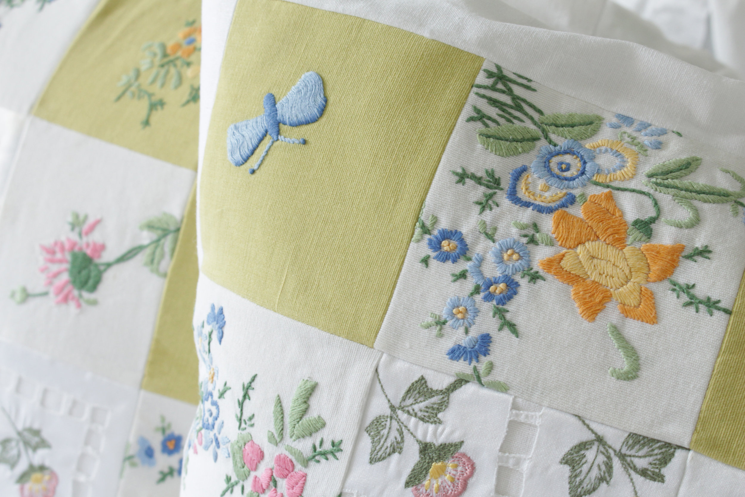 Aunty Ivy's beautiful hand embroidered table cloth made in to two cushions.