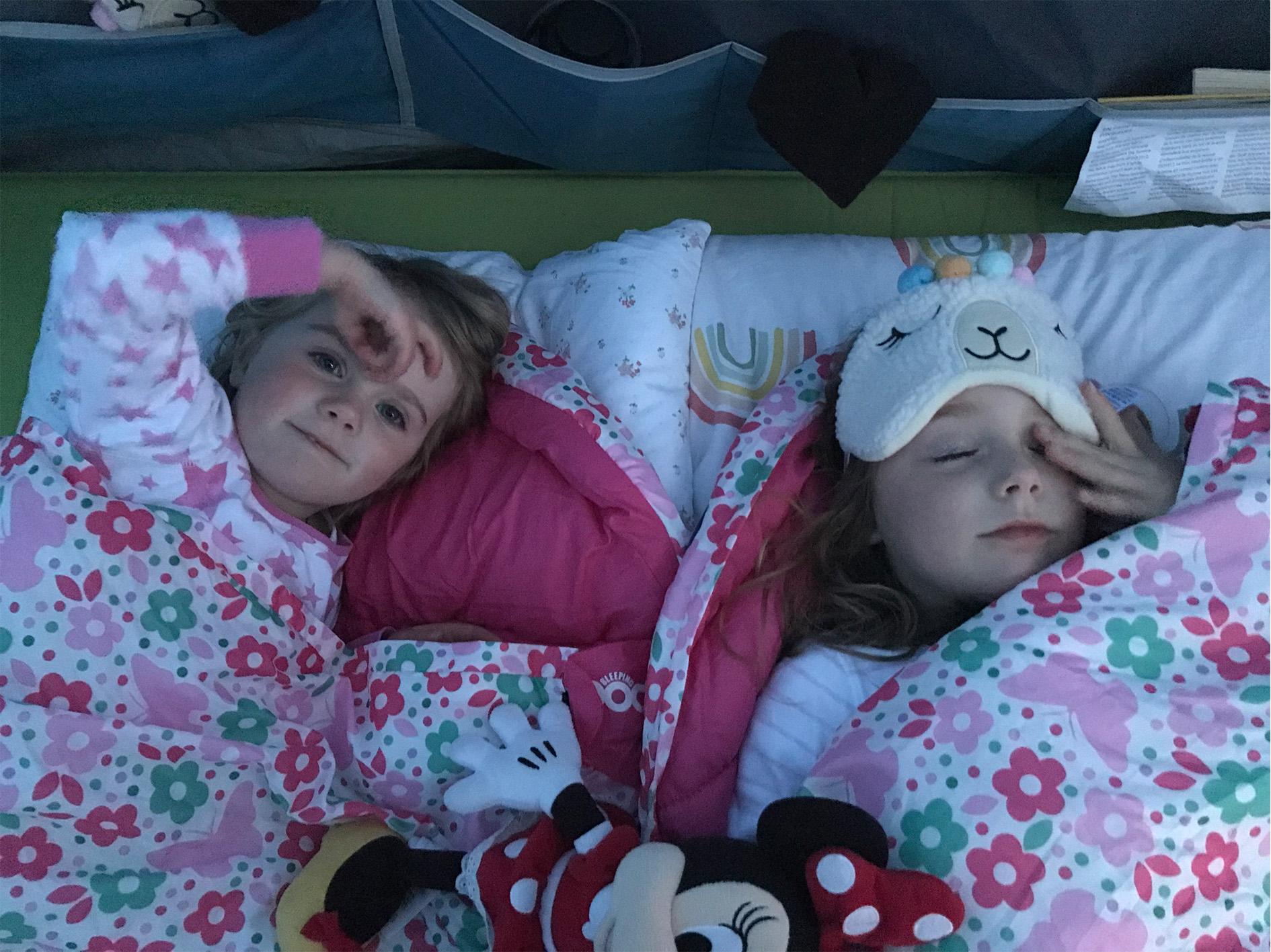 Sleepy kids lovng the camp beds!