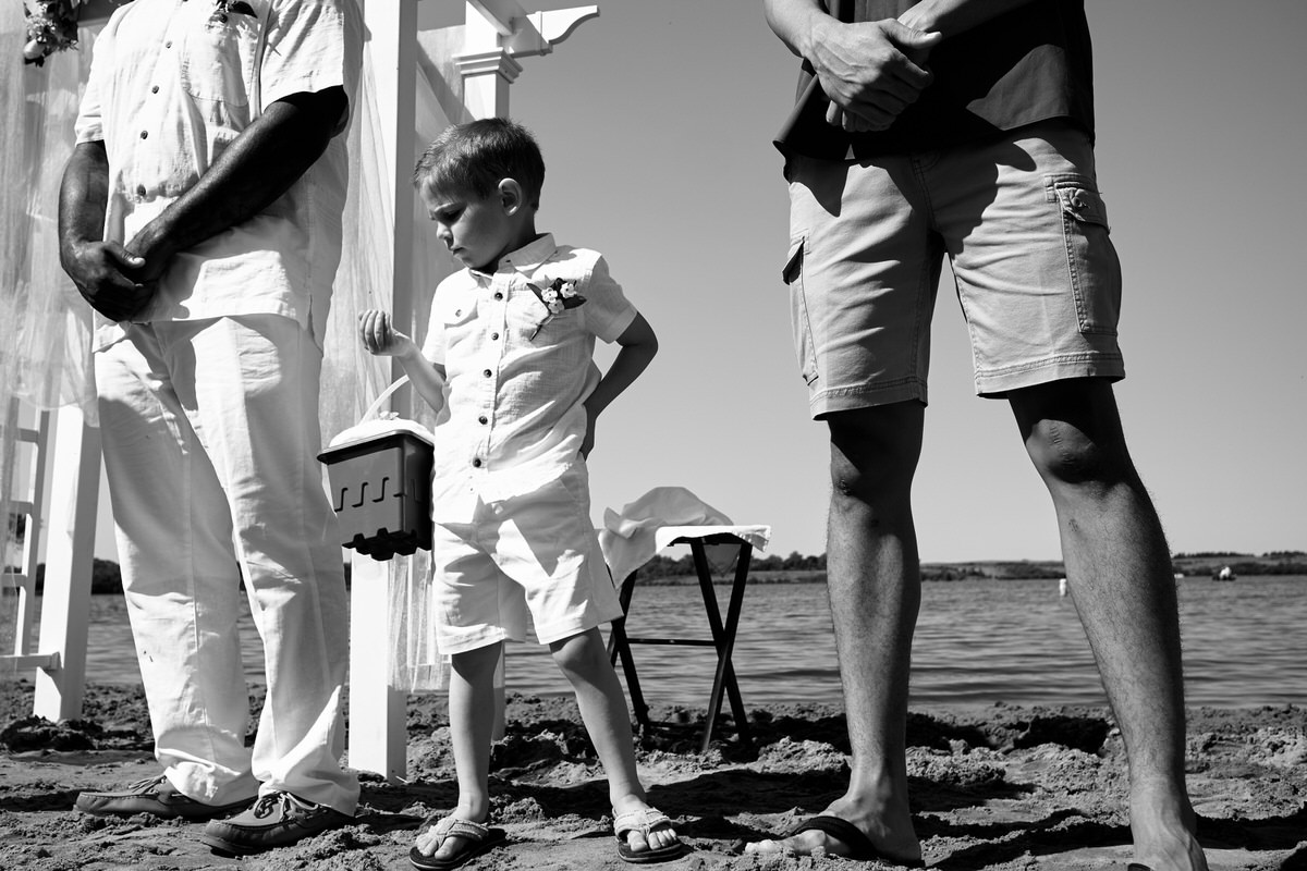 A ring bearer plays during a wedding ceremony in Iowa