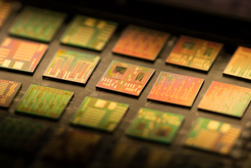 Example photonic integrated circuits produced on the indium phosphide platform for sensing and communications applications