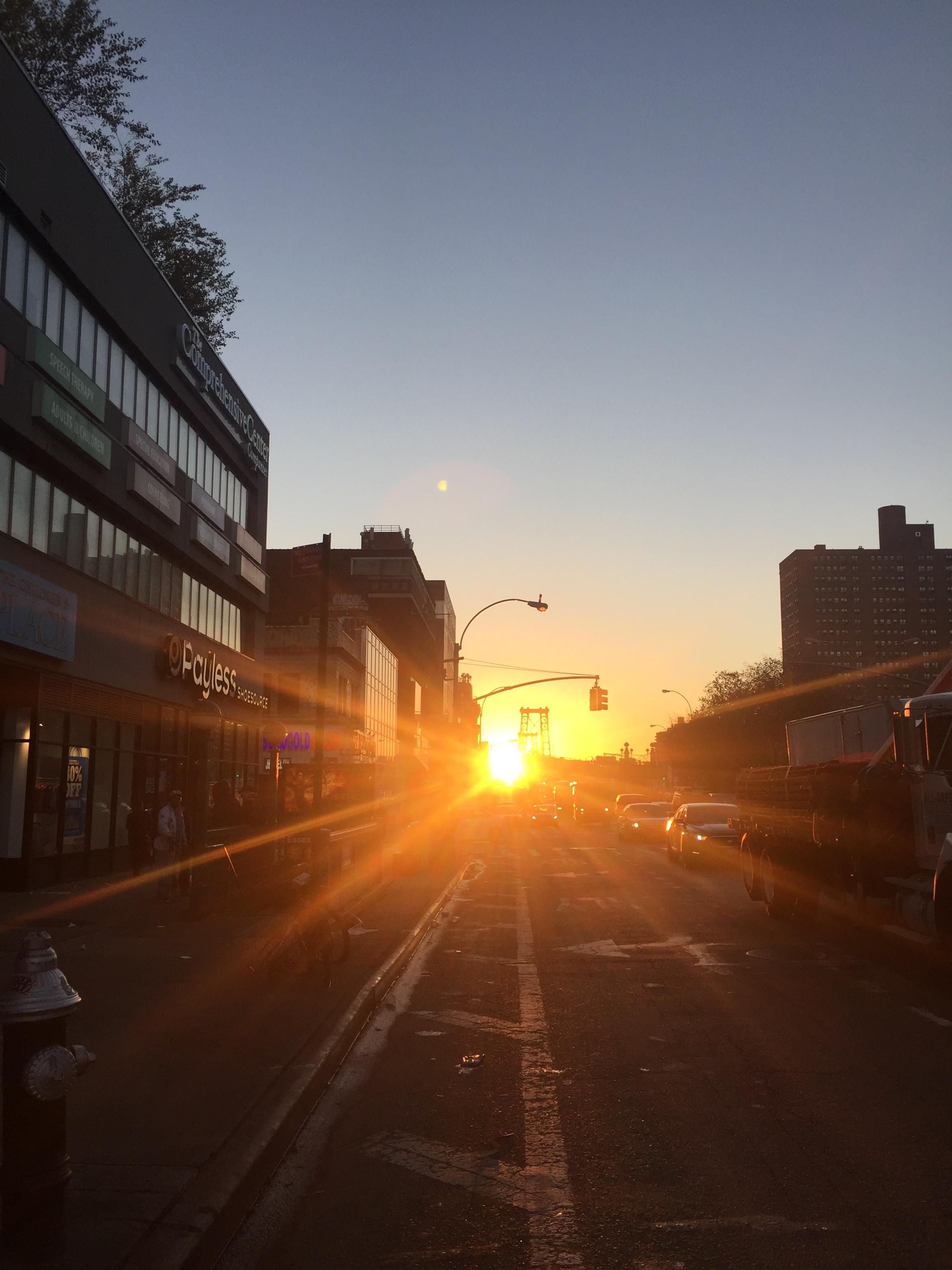 sun rising up the Williamsburg Bridge
