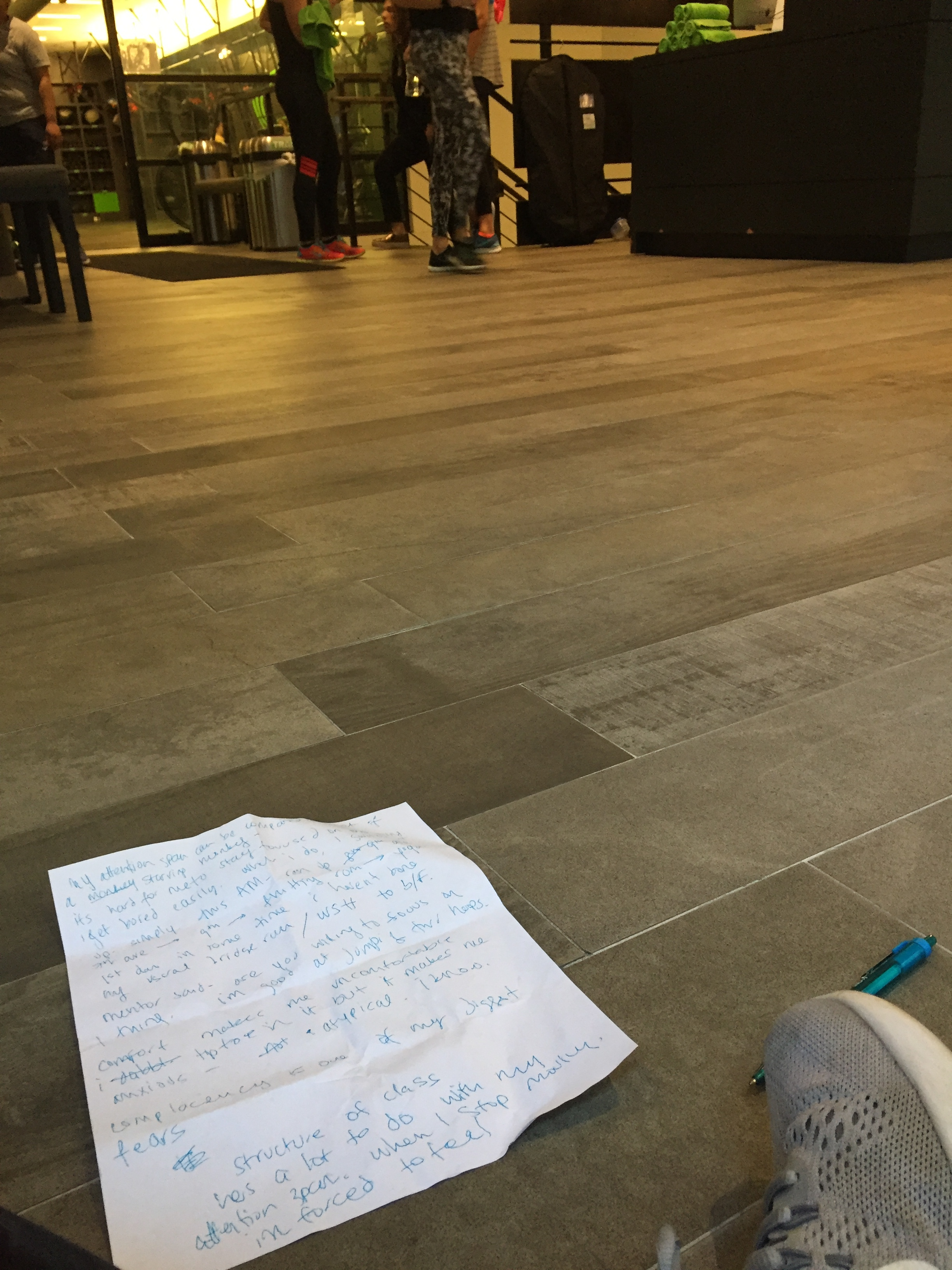 sitting on the fhitting room floor before class, writing all my mid-running thoughts