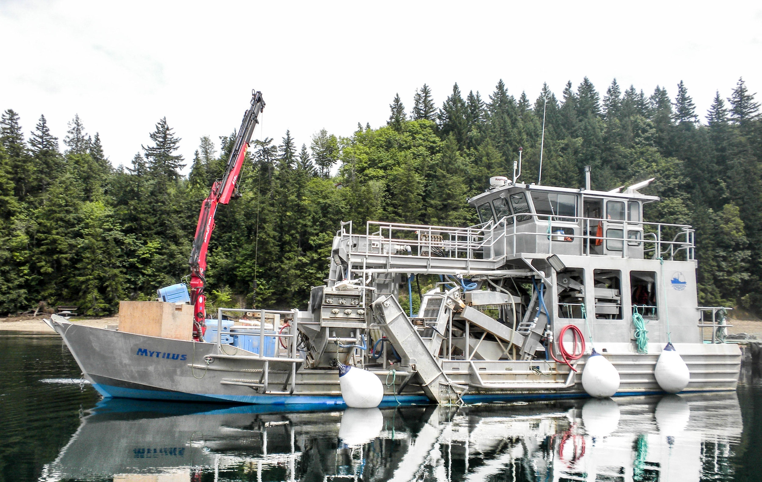 "Our Harvest vessel, the ""Mytilus"", based at our Quilcene Bay mussel farm site.  This vessel and the rest of our boats and equipment were manufactured at our fabrication shop doing business as Everest Marine."
