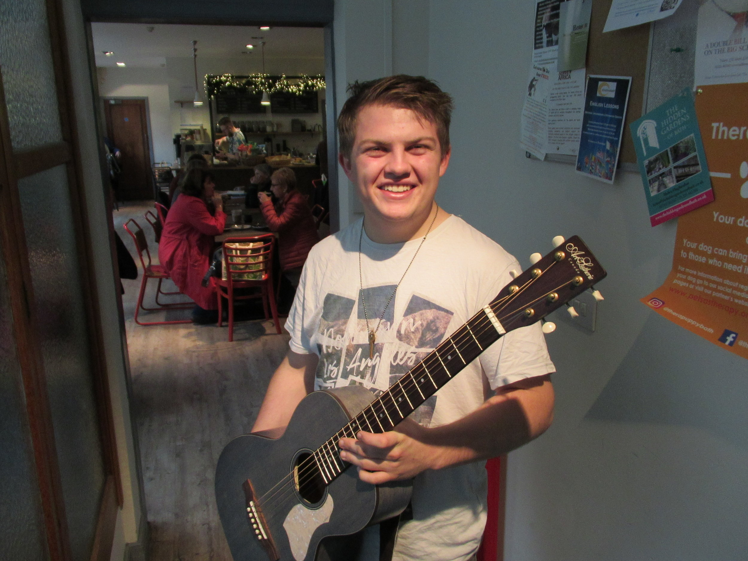 Bath Spa student Ed Axtell with the guitar provided by the William Cross Foundation