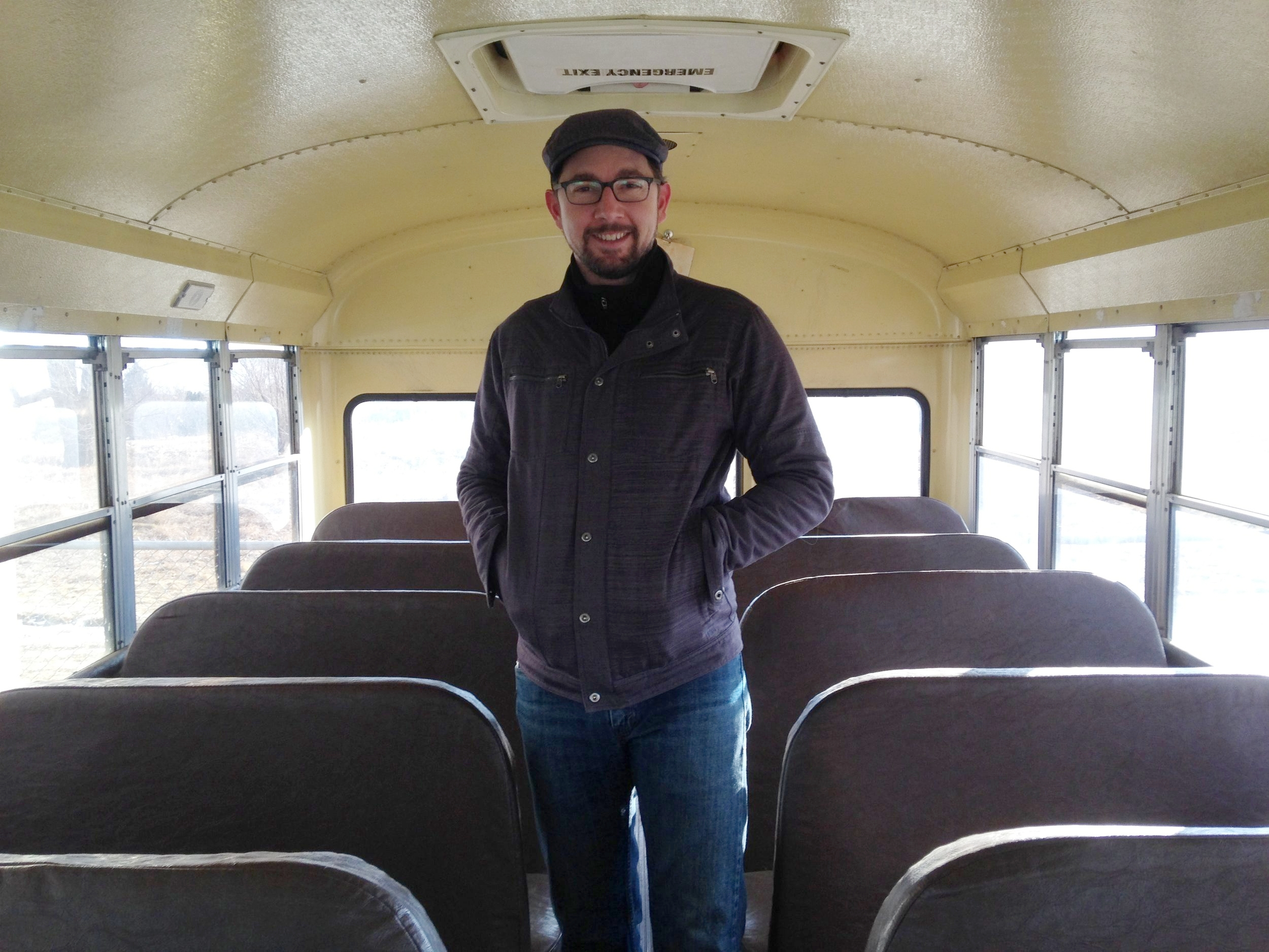 Aaron Winston, Pottery Lab Director, checks out the bus