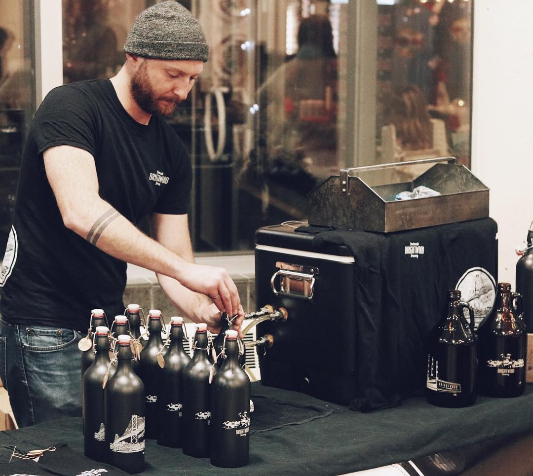 Ian doing growler fills/ keeping his head toasty