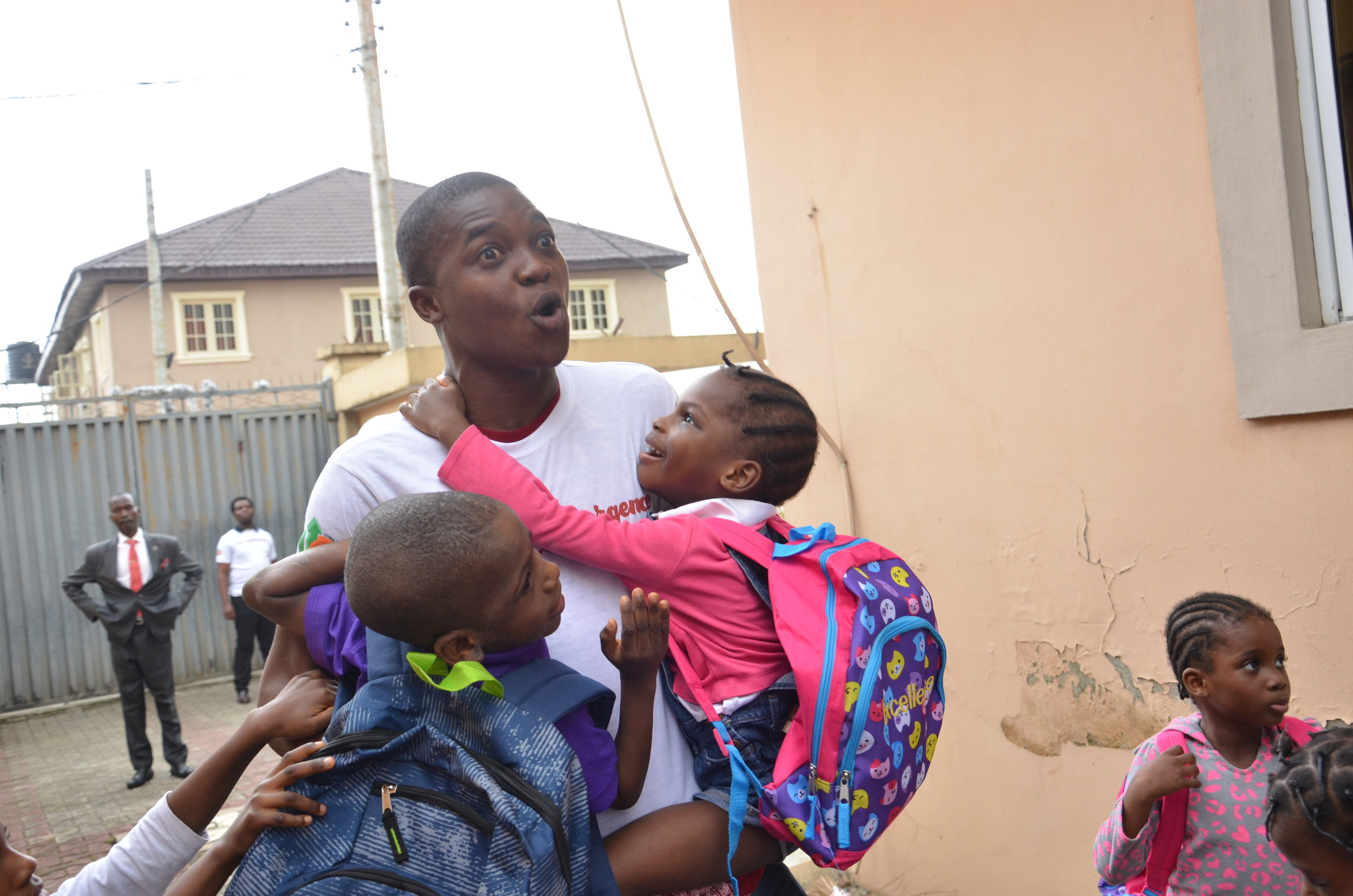 Grateful & very happy constituents :). Orpahange children hugging a volunteer after receiving gifts.