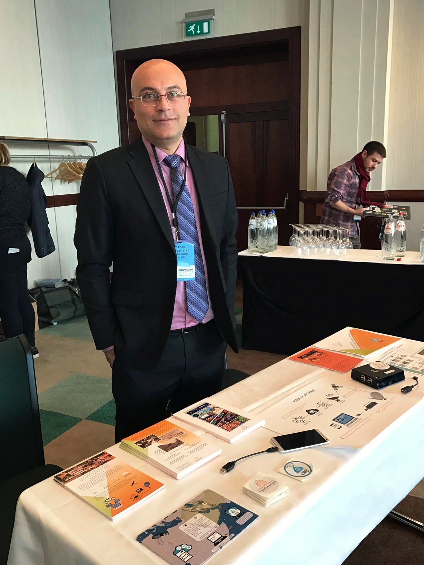 Executive Director Mehdi Yahyanejad represented NFP at a RightsCon booth by providing information, answering questions, and handing out swag related to our innovative technology.