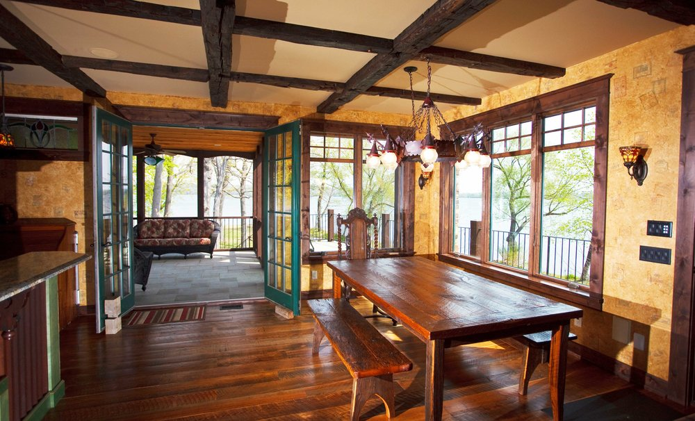 Dining Room With Hand Hewn Beams and Farm Table