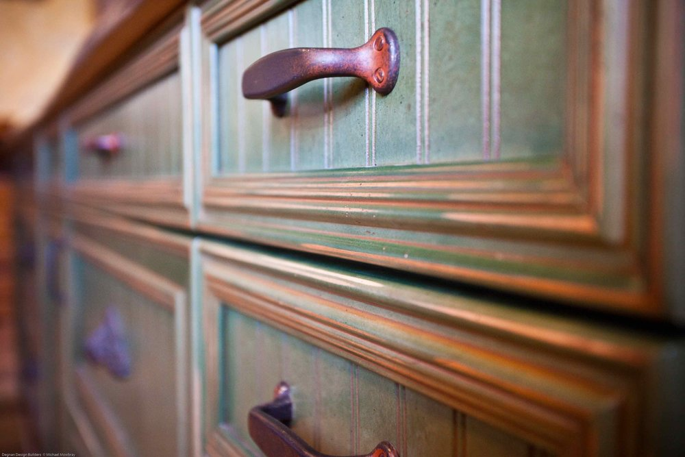 Hand Robbed Green Cabinet Finish with Distressed Hardware