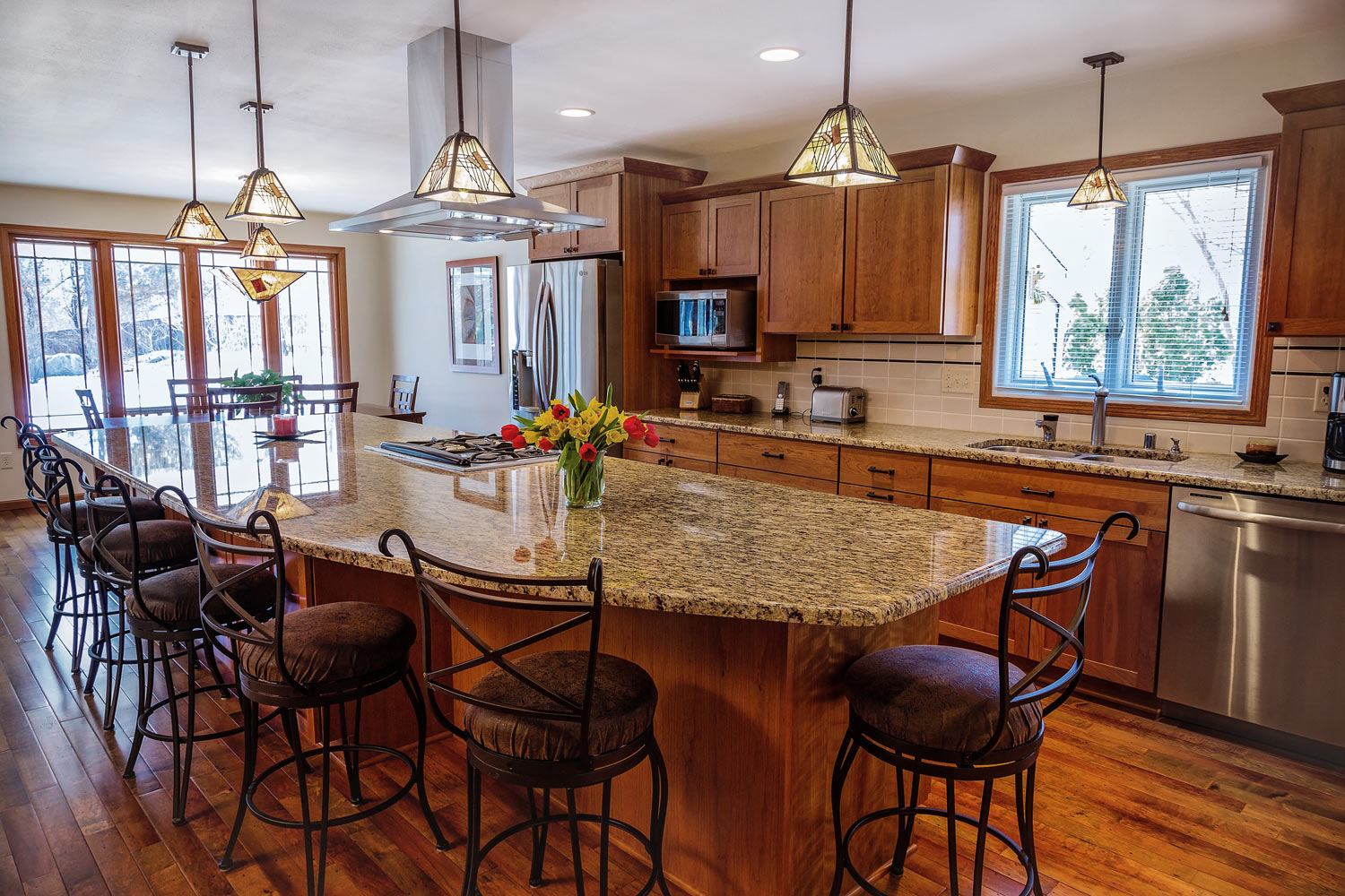A Kitchen Island With Seating For Six