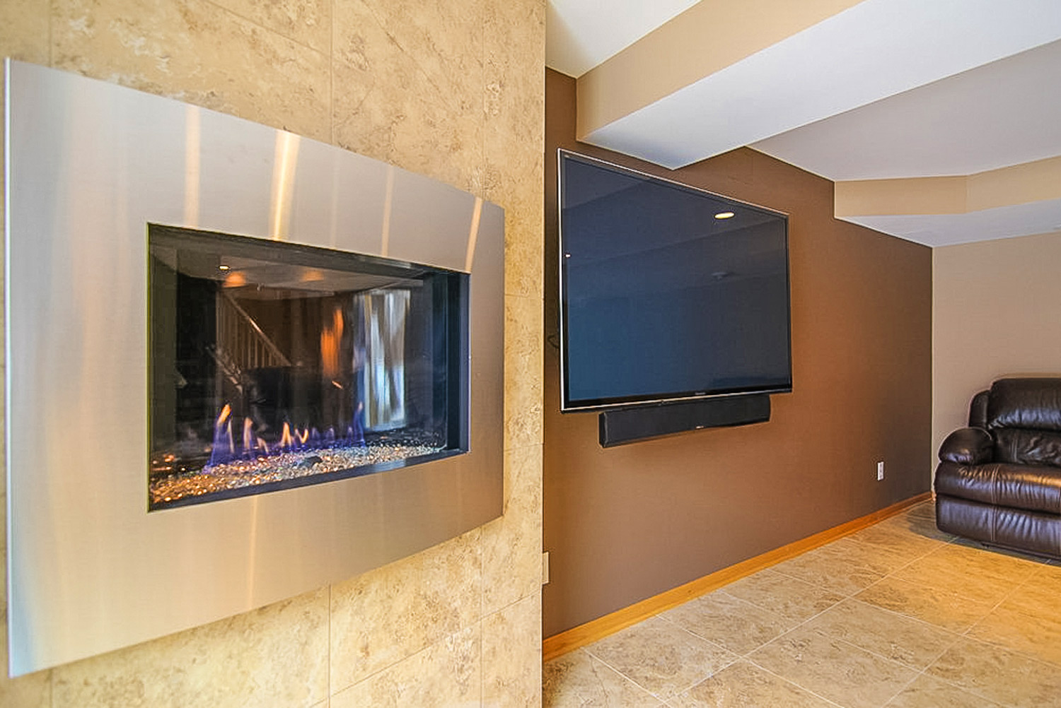 Modern Stainless Steel Fireplace and Flat Screen TV