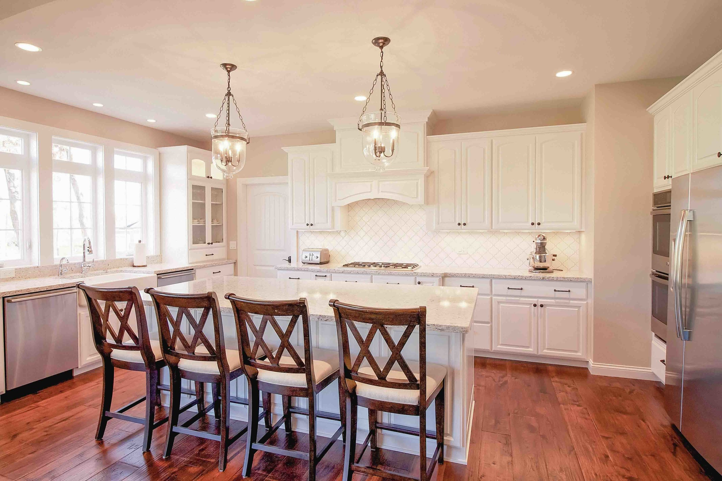 - A classic French Country kitchen with a concealed range hood.