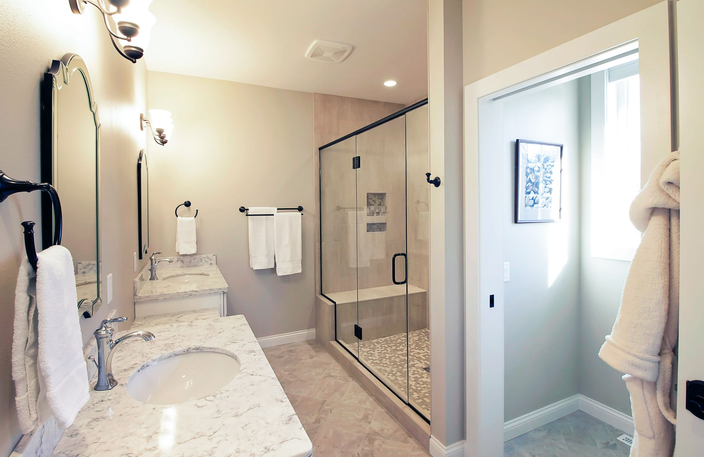 - This glass shower wall has a special coating to help prevent water spotting.