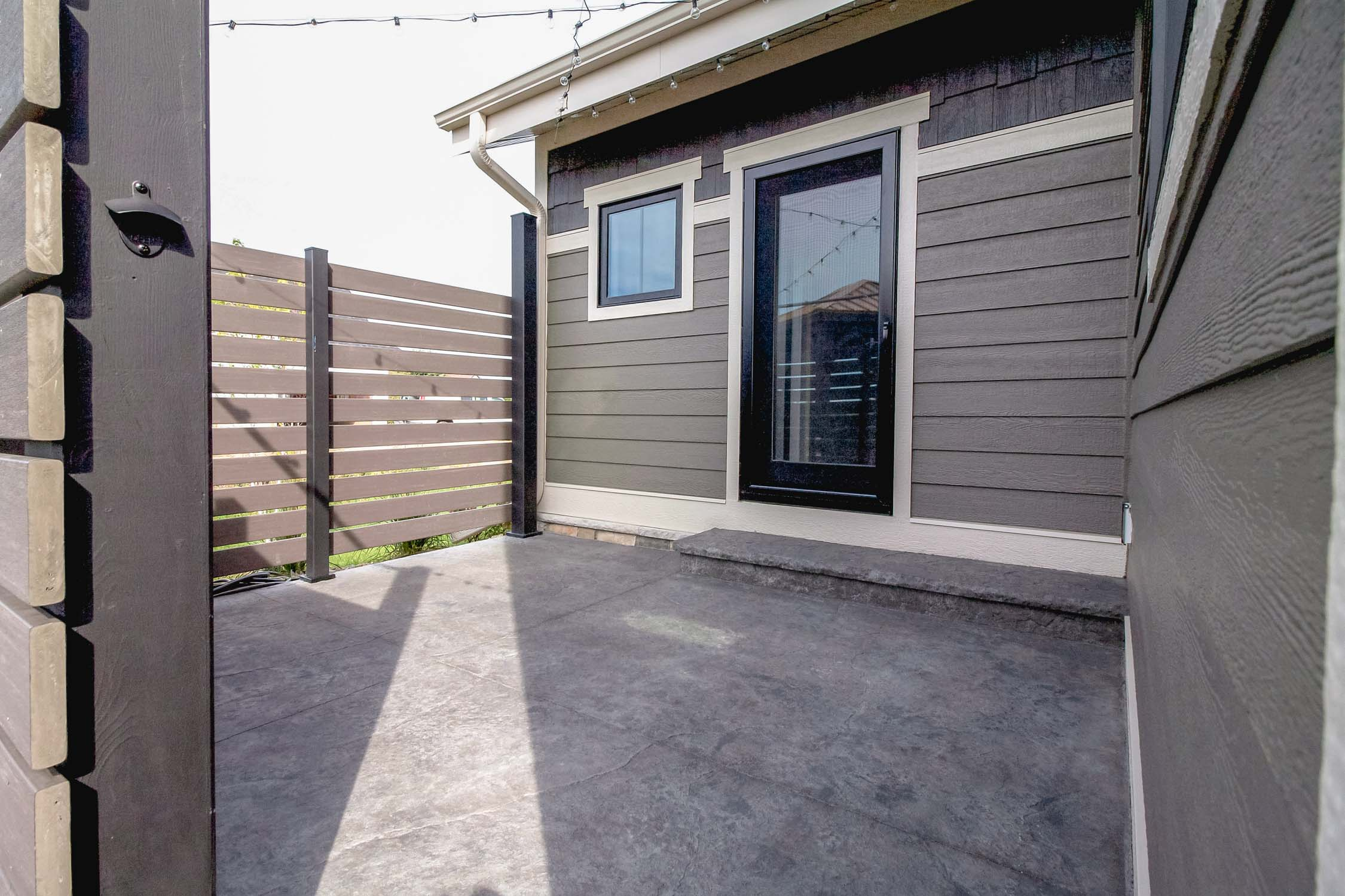 - This outdoor space provides privacy to the master bathroom, and transition from the luxury patio just outside.