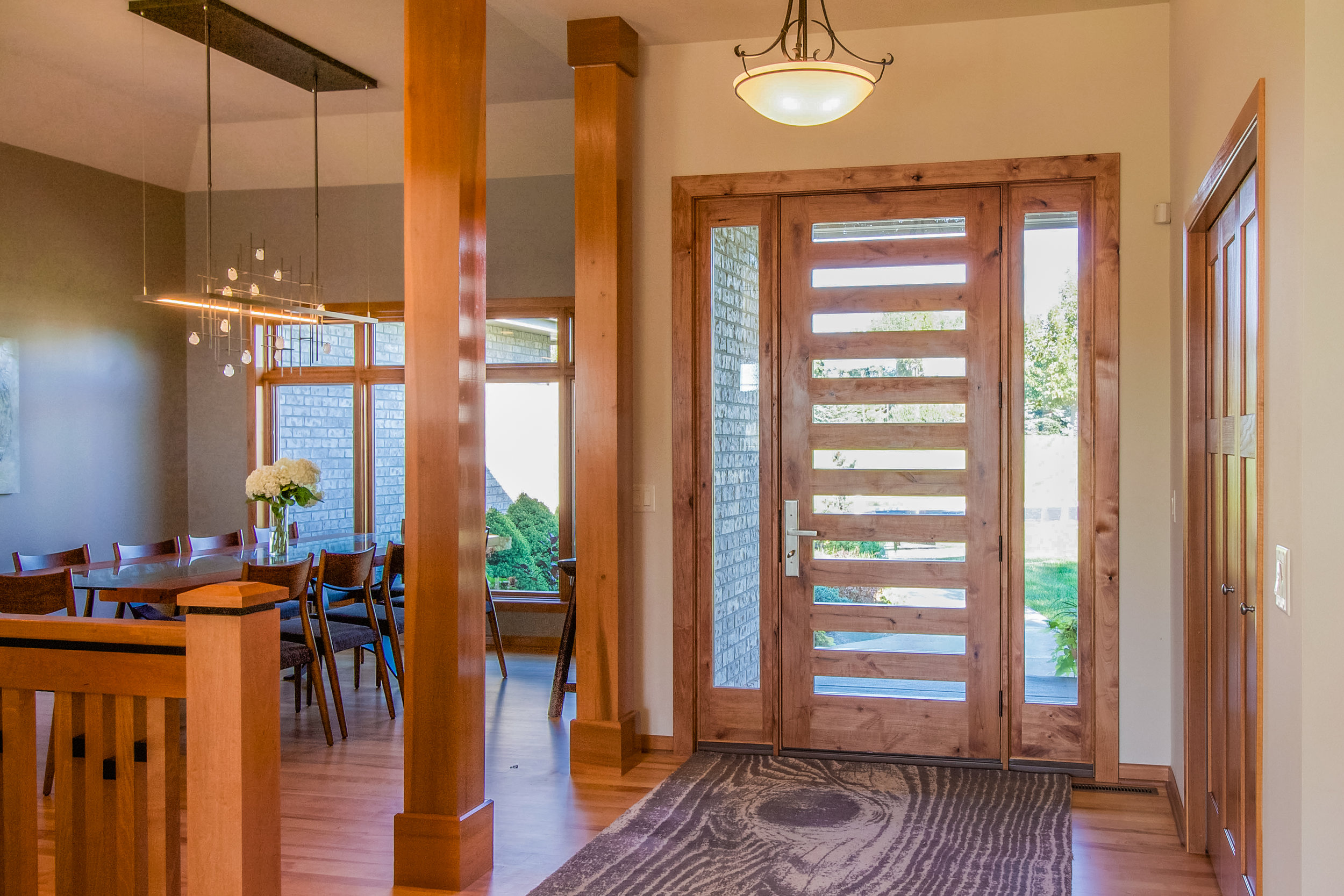 - This contemporary wood door by Jeld-Wen was installed to transform the style of the home from ordinary to extraordinary. To learn more about the transformation in other areas of the home, follow the photo link.