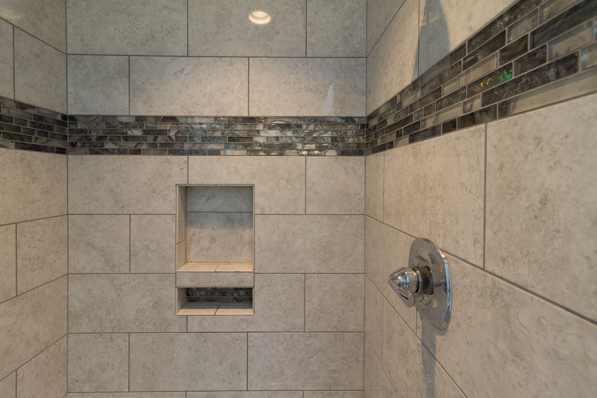 A Fiberglass Shower Stall Was Replaced With New Tile