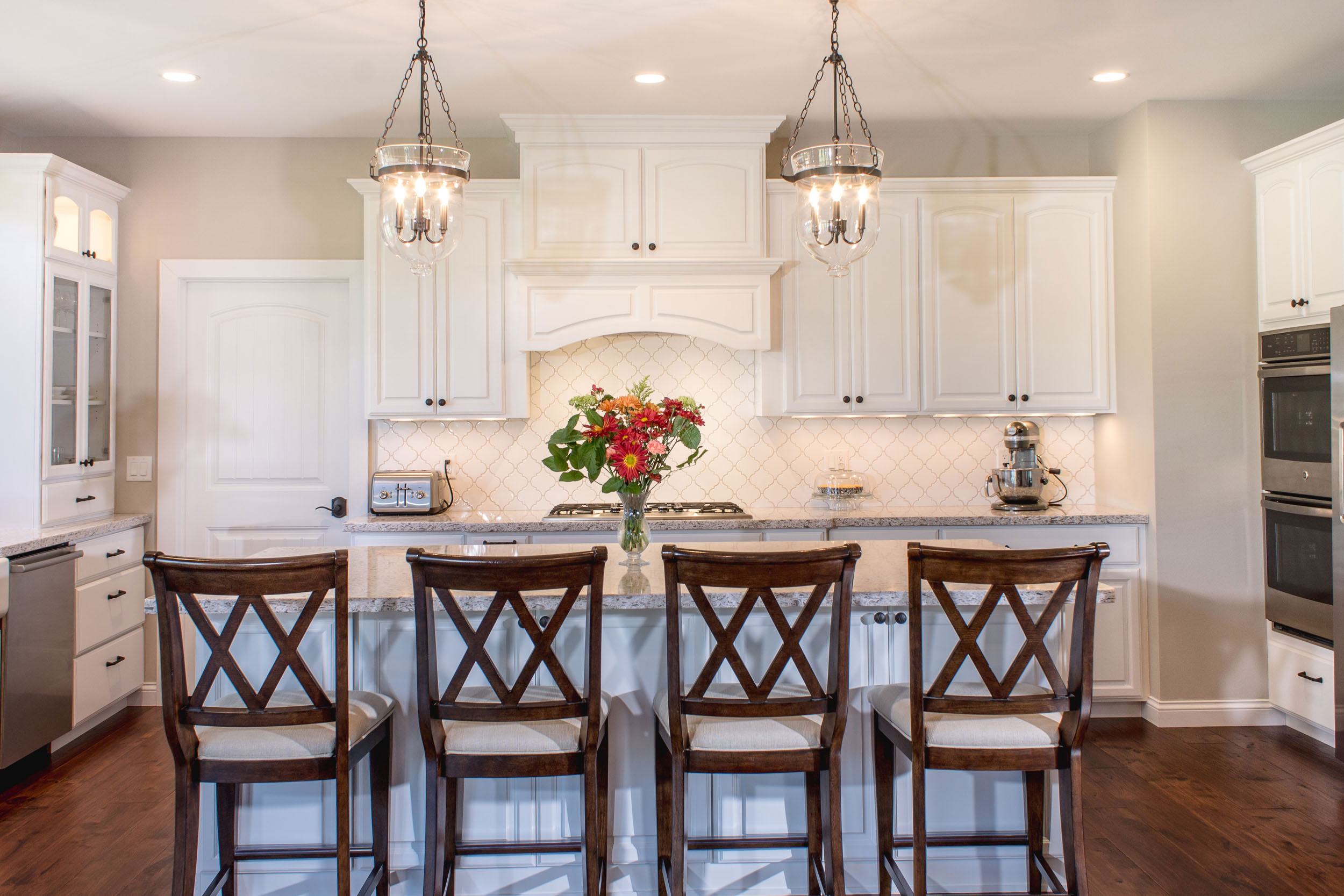 Auburn Ridge Cabinetry in Maple With Williamsburg Arch Doors And Williamsburg Slab drawer fronts