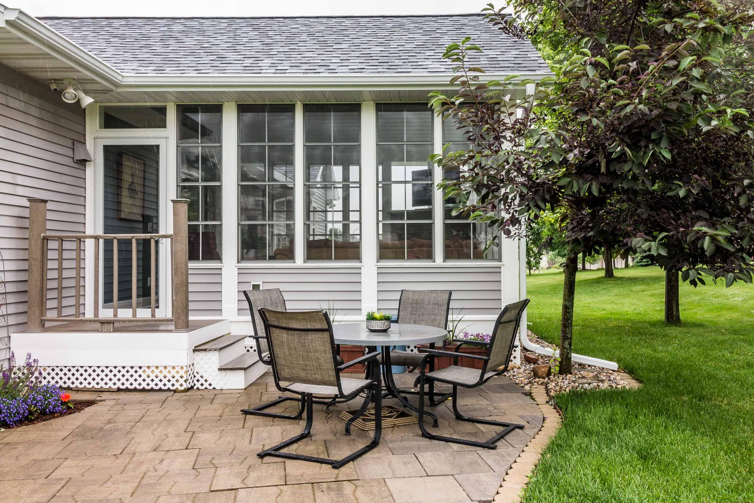 Three Season Porch With Adjacent Patio