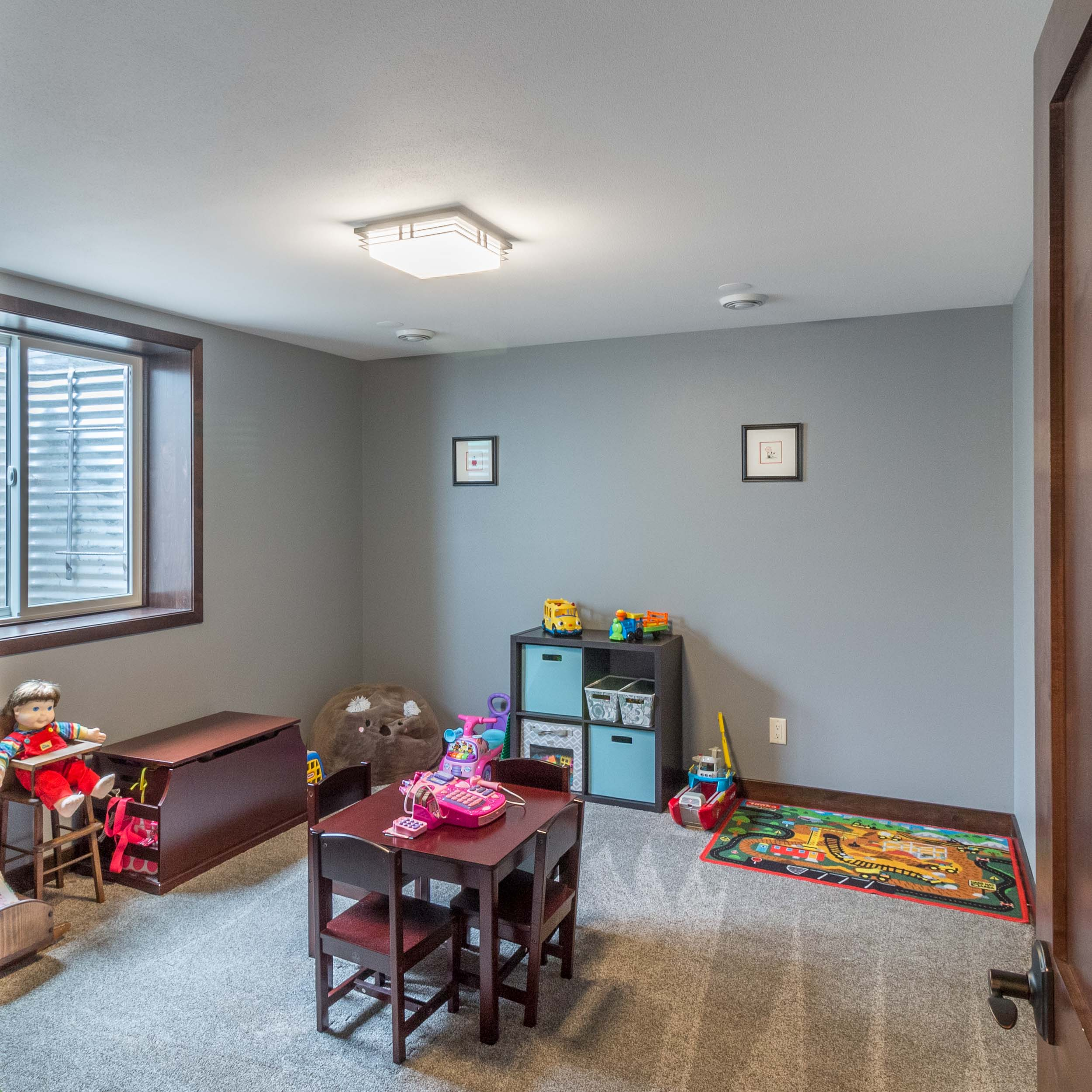 Carpet in a Basement - Carpet is an ideal choice for a child's playroom. It is soft underfoot, and provides a warmer floor and creates a quieter room.