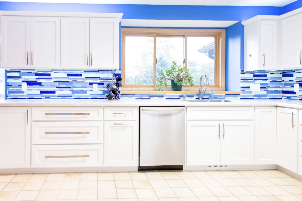 Glass Backsplash Tile - This remodeled kitchen in Windsor, Wisconsin uses a linear glass tile in a vibrant blue color. Glass tile is oven a luxury splurge, and can cost anywhere from $30 to $100 per square foot.