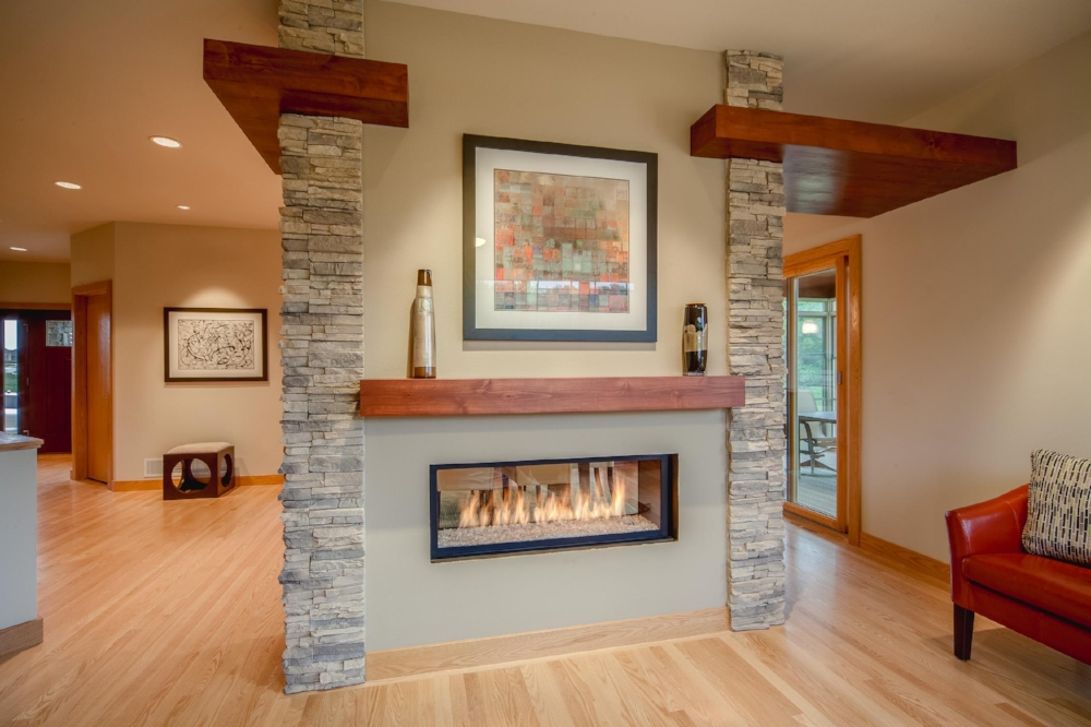 Contemporary Prairie Linear Burner Gas Fireplace - The contemporary prairie design of this home is complimented by a linear burner fireplace. Instead of a traditional square firebox and immitation gas logs, this fireplace uses glass beads and a large flame in a horizontal, rectangular firebox.