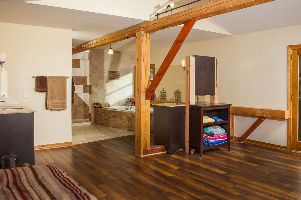 Great Results - A professional design build company will be able to create a beautiful and unique solution for your bathroom remodeling. The constraints of this timber framed home lead to several unique solutions.