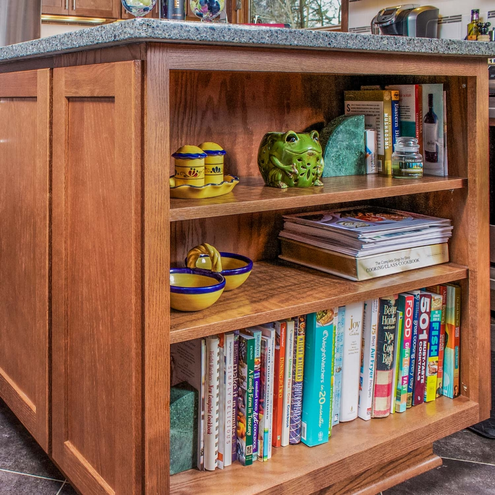 Cookbook Storage - End of Island book shelving is used for function and decor at this kitchen remodel in DeForest, Wisconsin.
