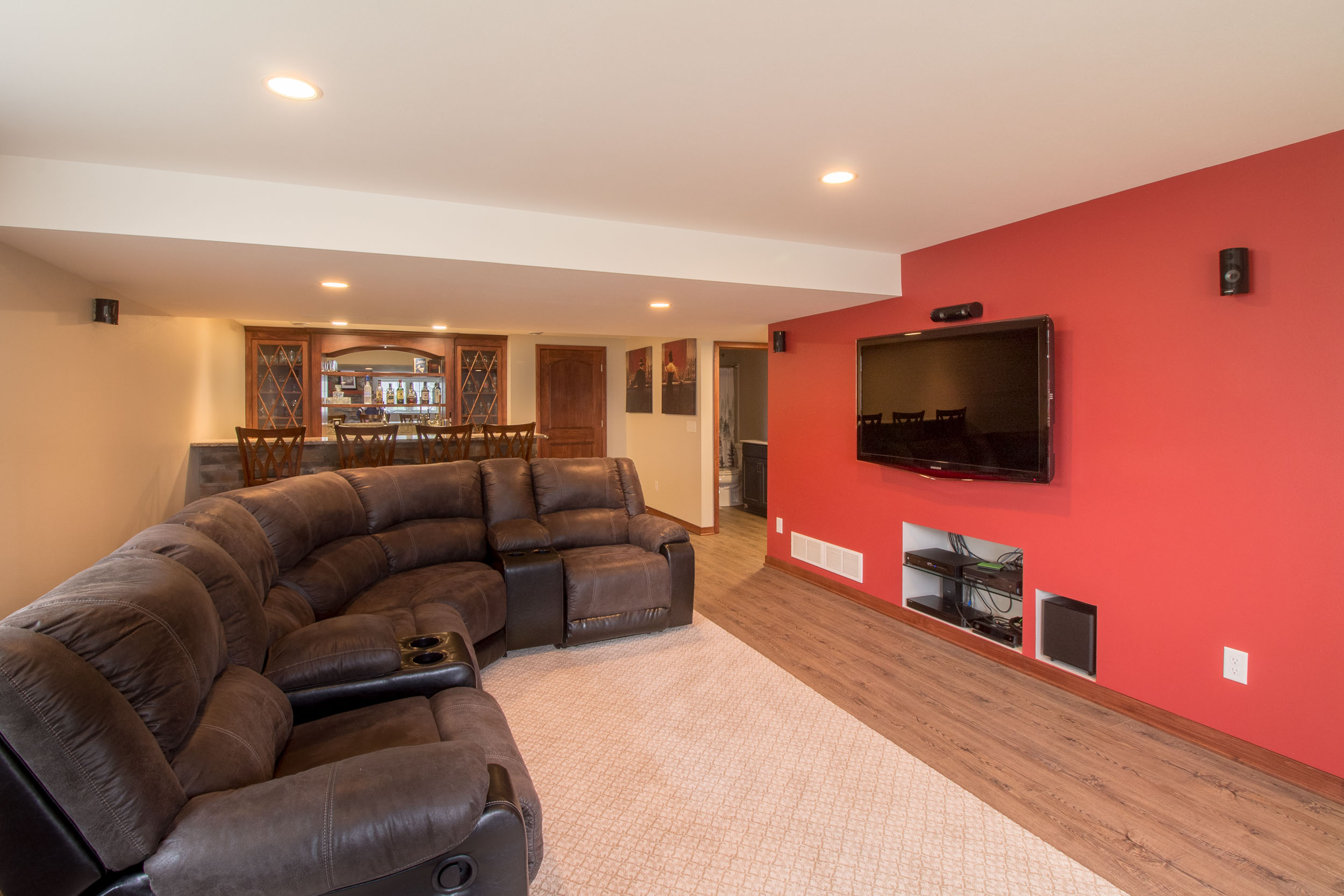 - A column was removed to create this open-concept living space in this finished lower level.
