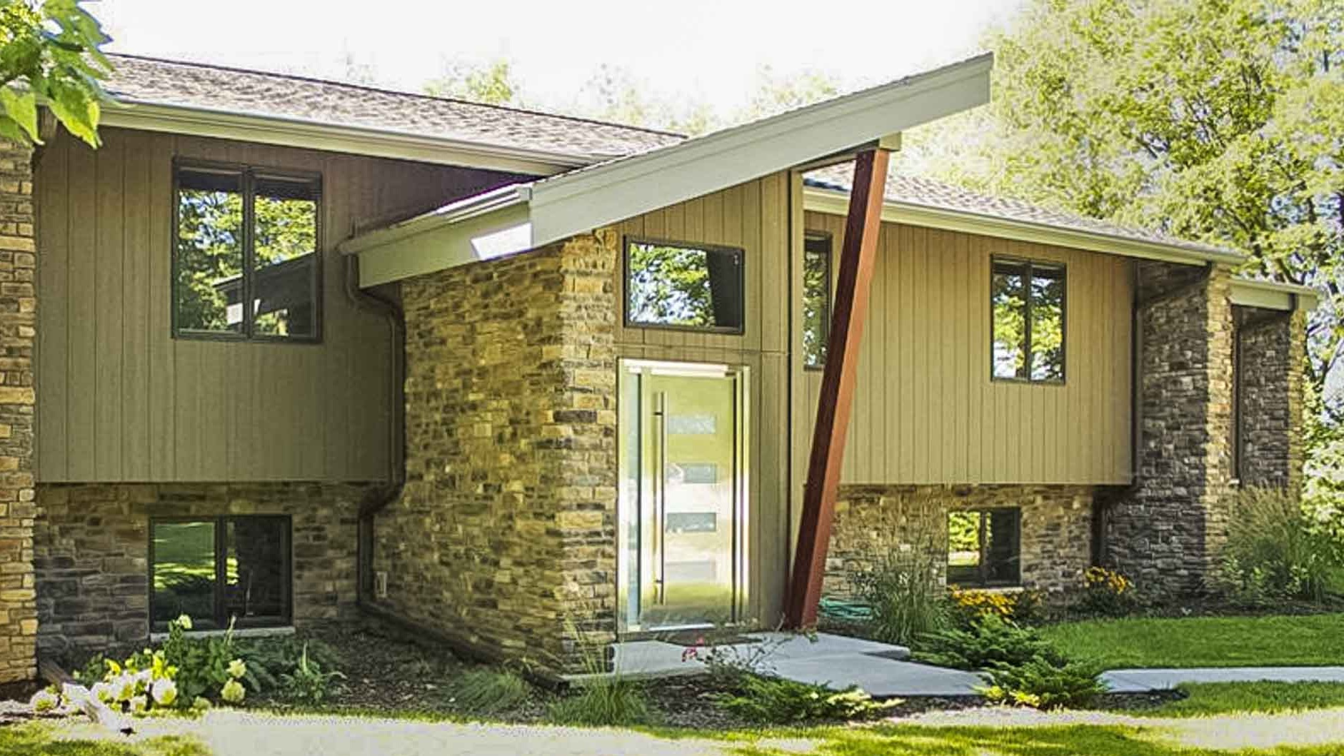 - This home had a modern front entry foyer addition with a steel column and concrete frost wall and footings.