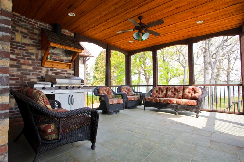 - The outdoor kitchen in this lake house uses a vented hood to exhaust grilling smoke.