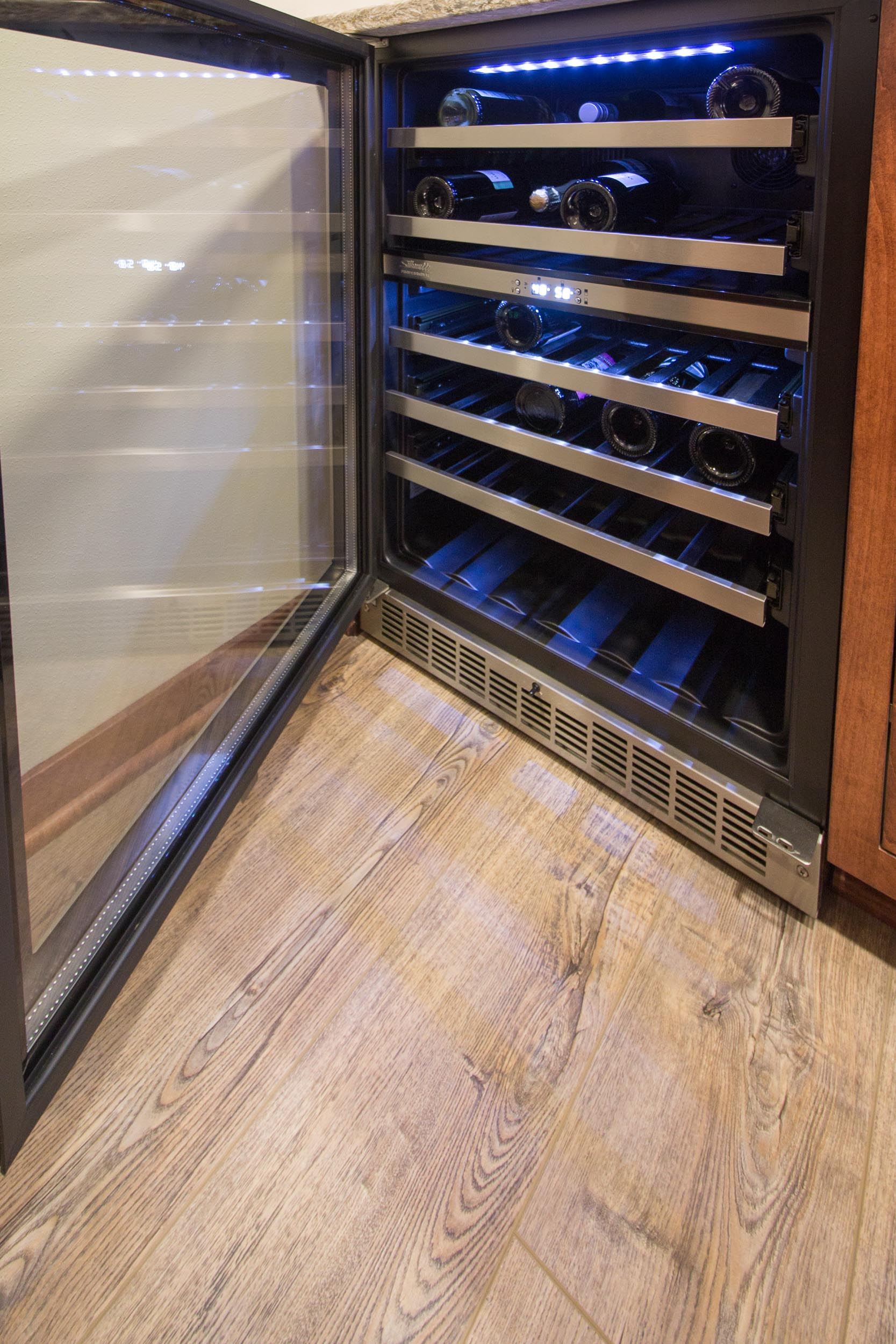 - This under counter wine cooler has different temperature zones for red wine and white wine.