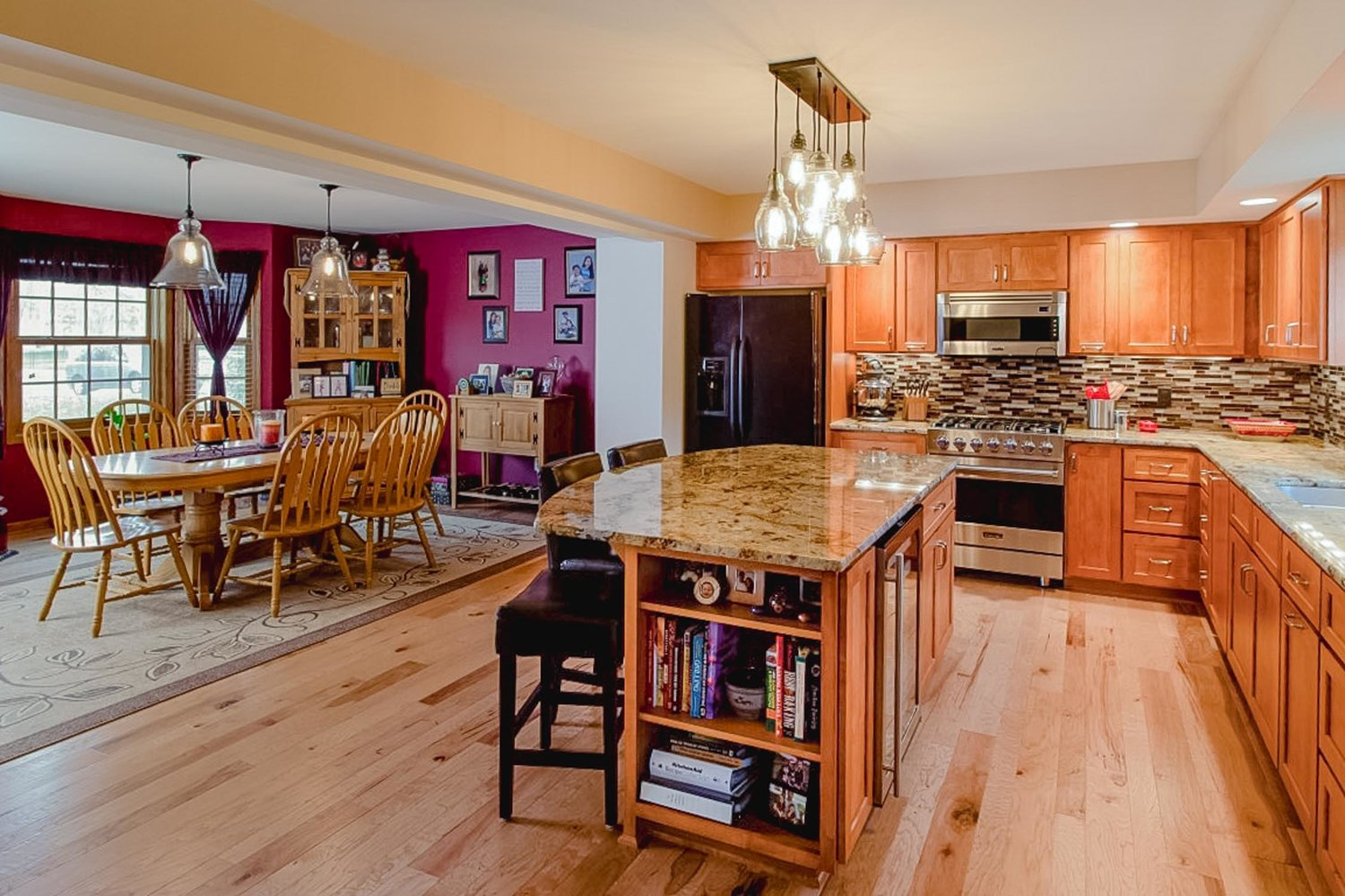 - A major loadbearing wall removal in this colonial home opened the space to make a larger kitchen with a usable dining room.