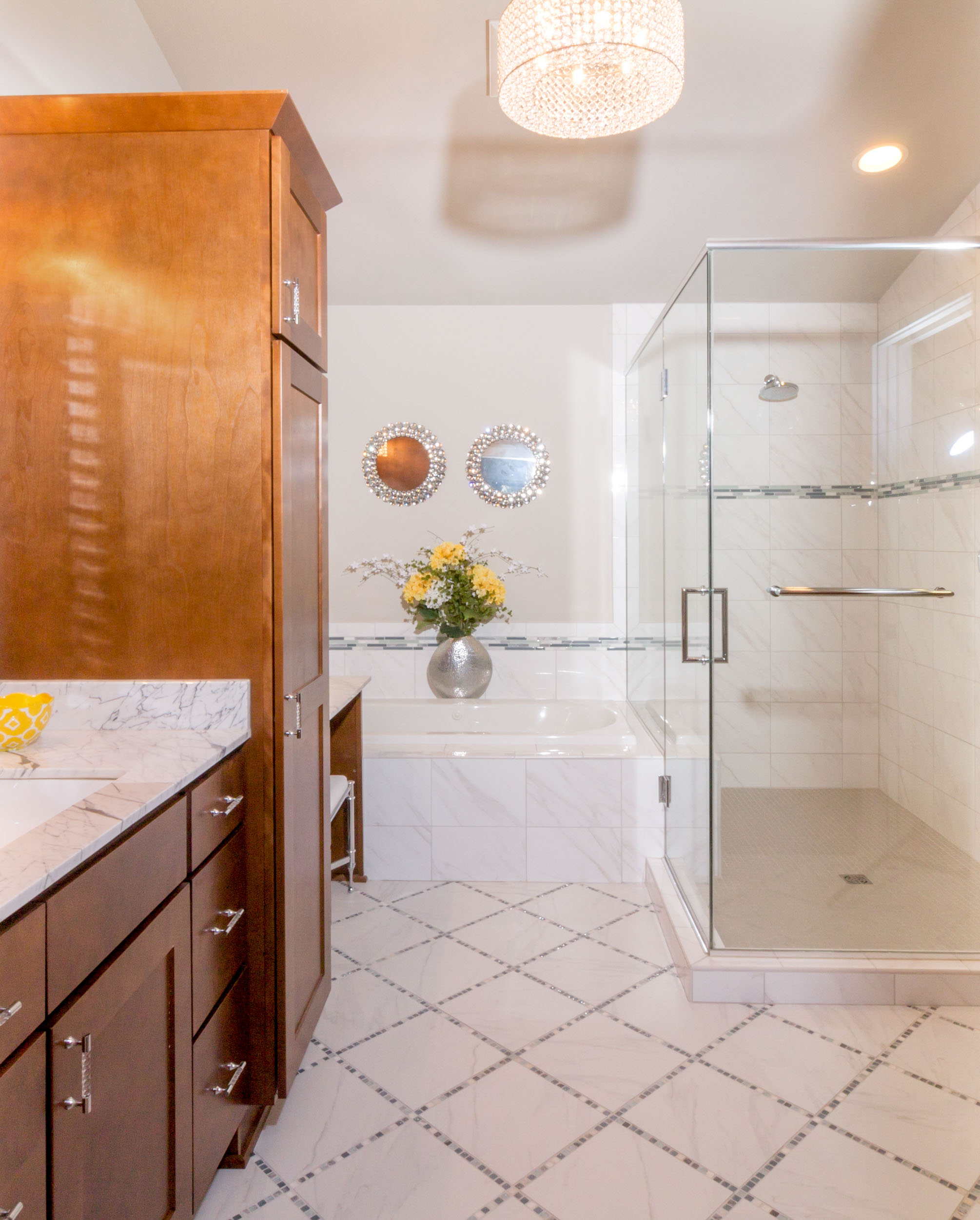 - This bathroom floor has a single stripe of mosaic in BETWEEN each square/diamond floor tile, creating a distinct grid pattern that carefully ties in with the tile design of the tub and shower surround.
